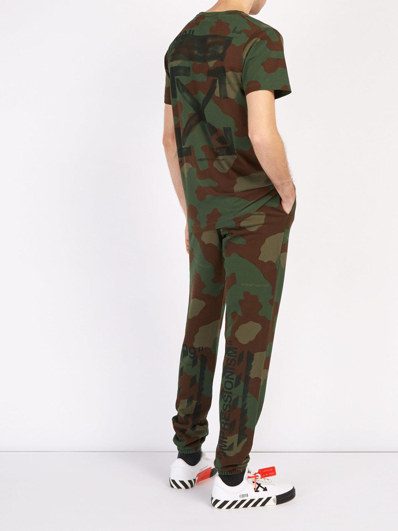045e5af0ab8f Lyst - Off-White c o Virgil Abloh Stencil Camouflage Print Cotton Track  Pants in Green for Men