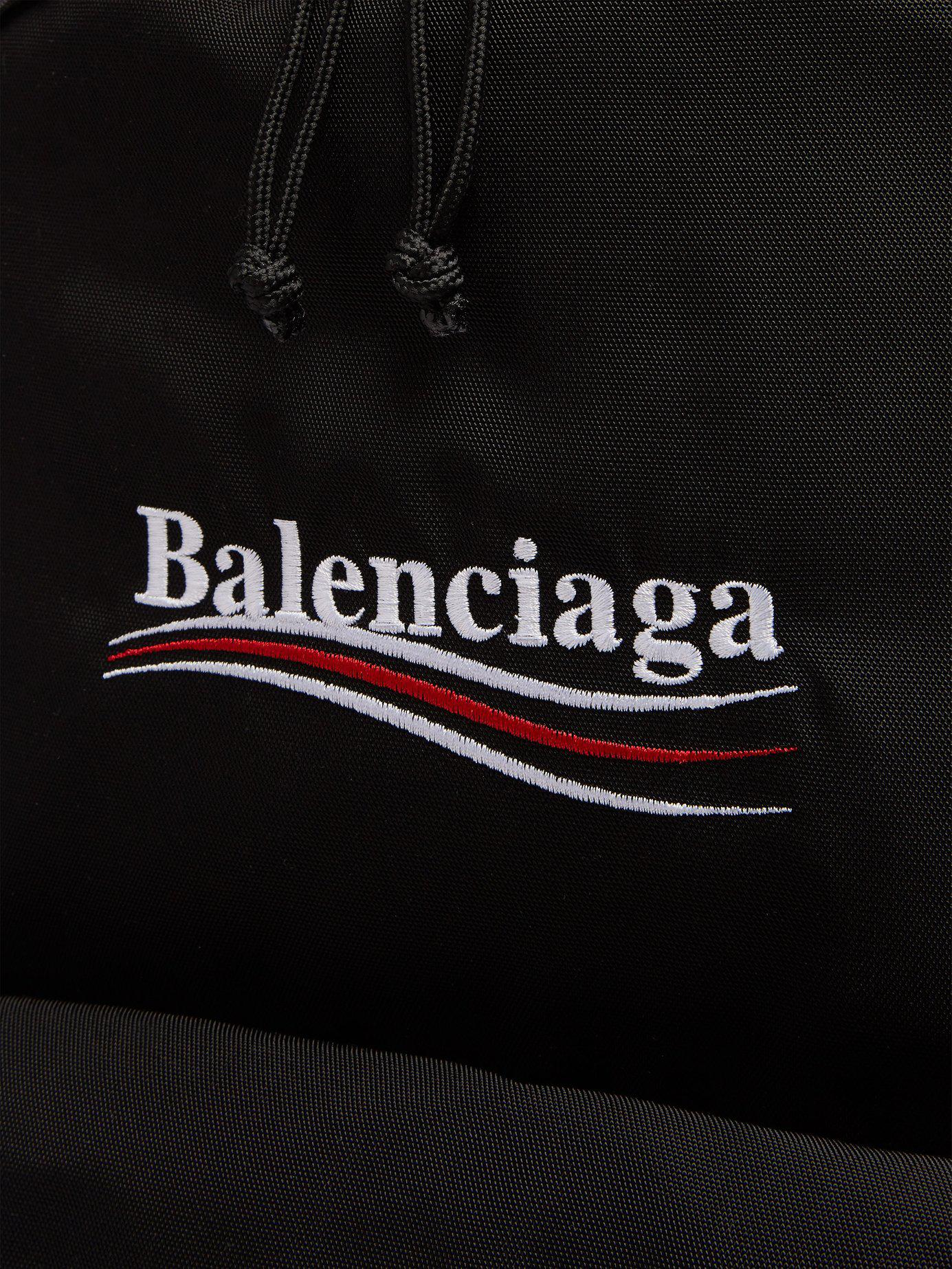 8f81bbd32917 Balenciaga - Black Explorer Logo Embroidered Coated Canvas Backpack for Men  - Lyst. View fullscreen