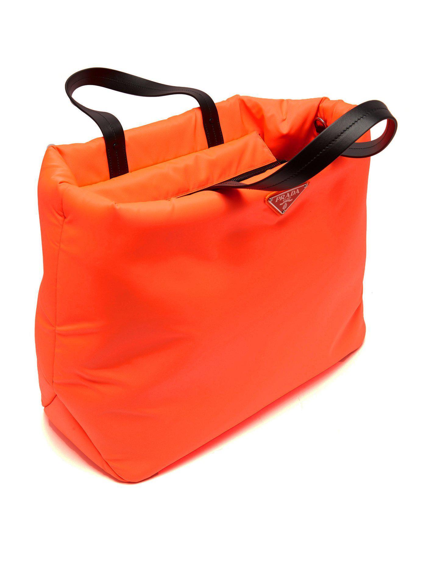 Prada - Orange Logo Embellished Padded Nylon Tote Bag - Lyst. View  fullscreen a74c9f1efd8f2