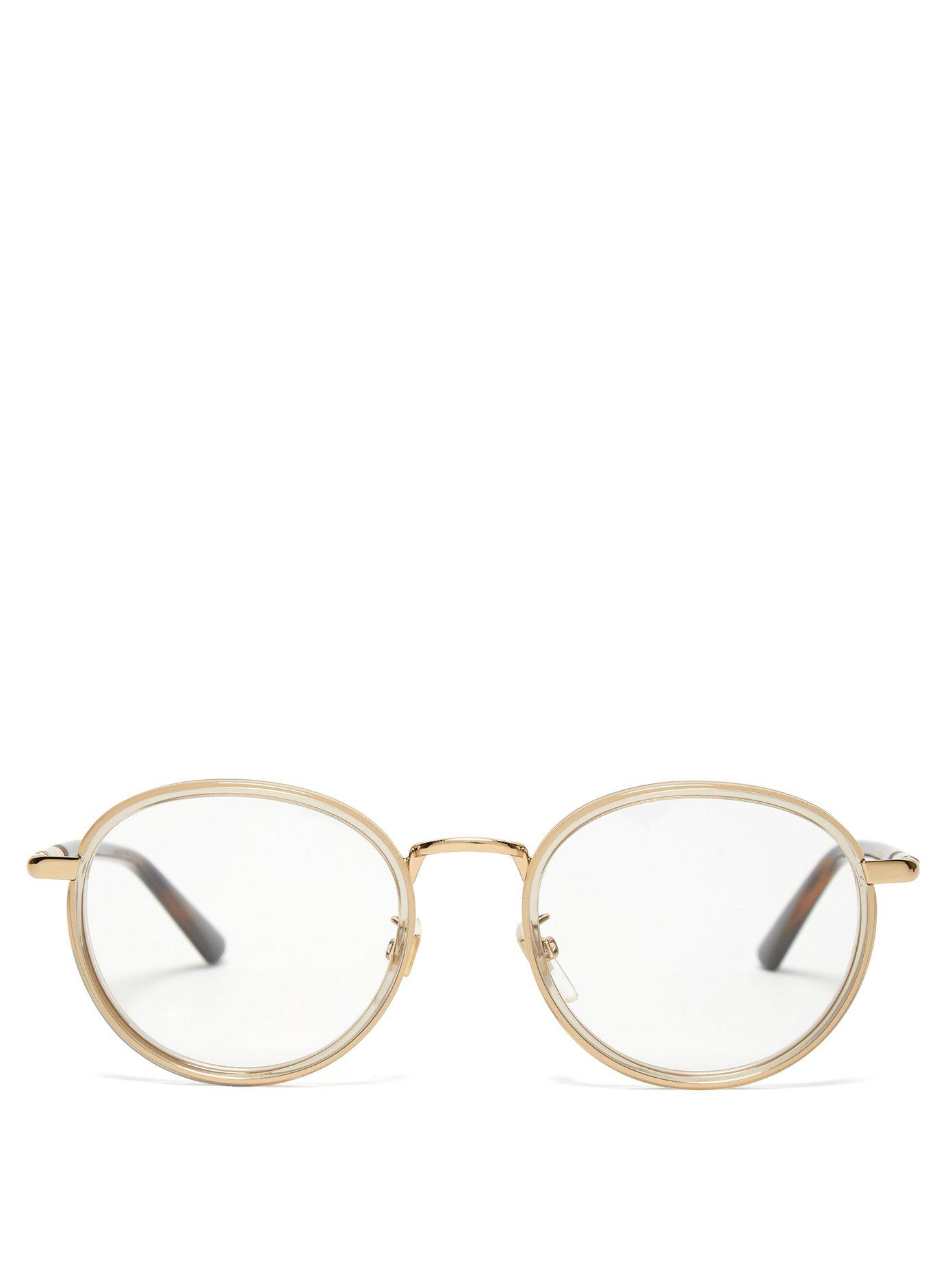 76a1043e26 Lyst - Gucci Web Striped Round Frame Glasses in Metallic