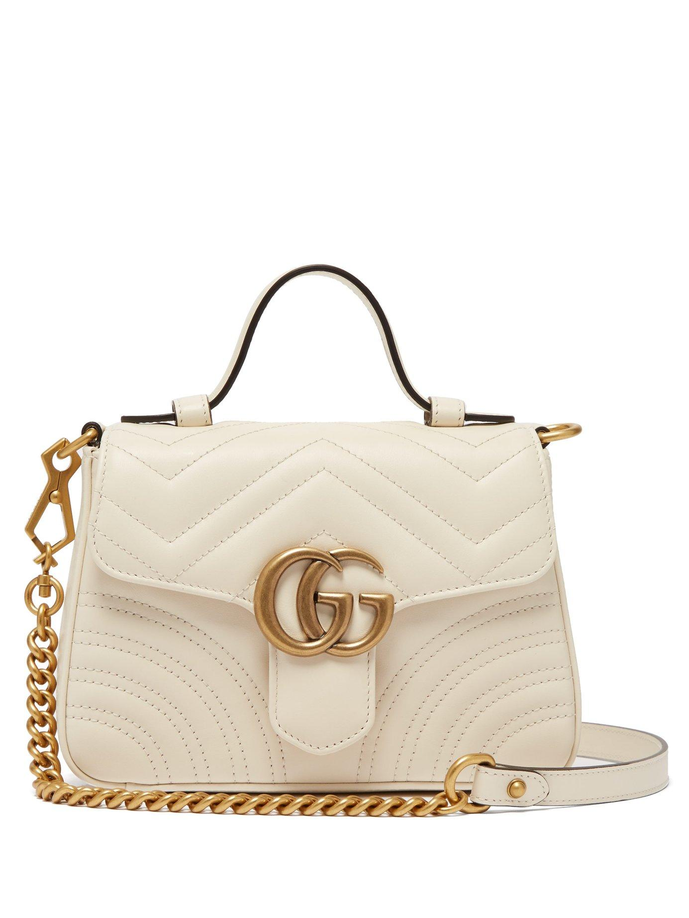 dd0a6c5c6 ... Gucci White Gg Marmont Quilted Leather Cross Body Bag · Visit  MATCHESFASHION.COM. Tap to visit site