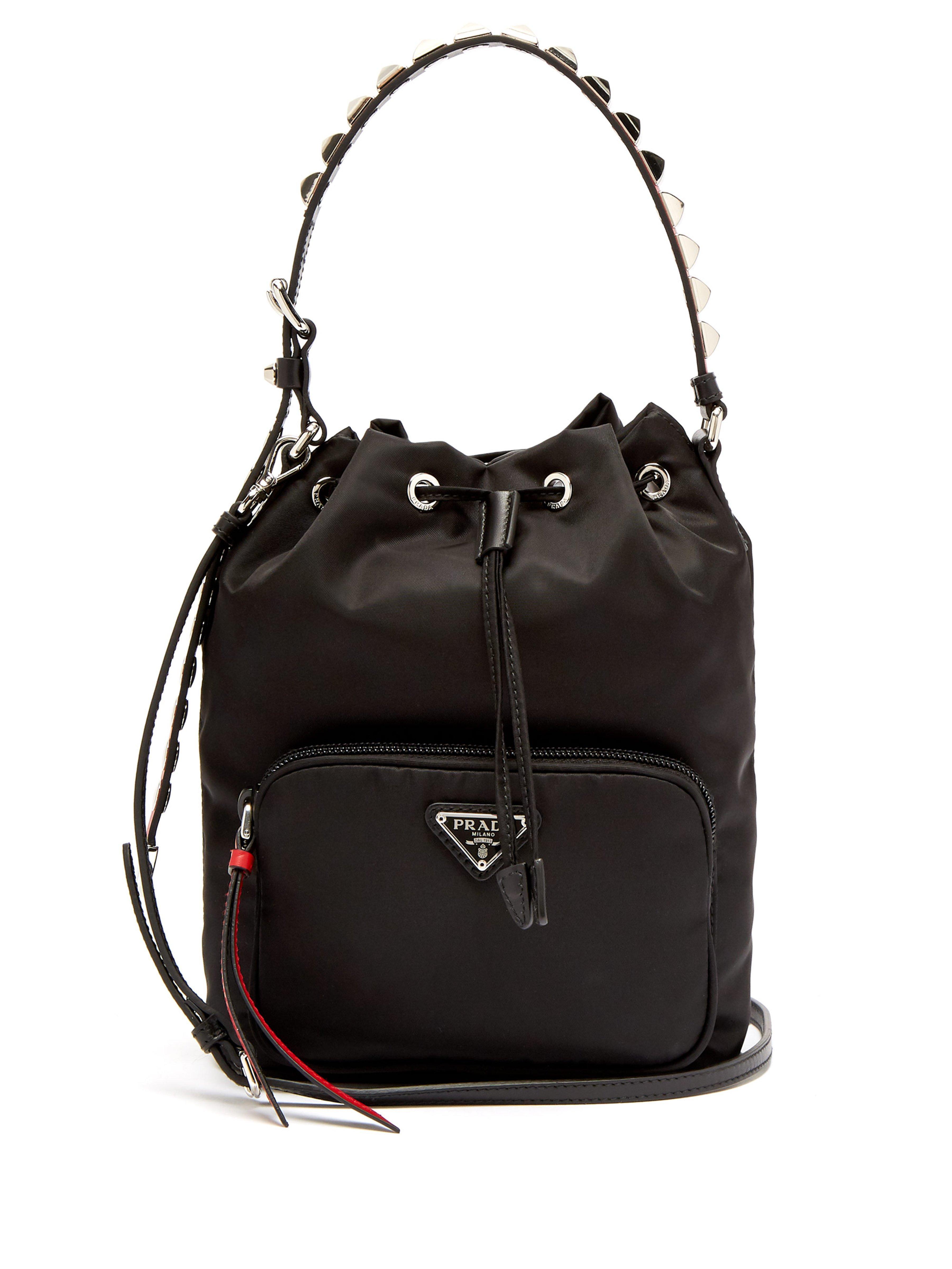 Prada New Vela Studded Nylon Bucket Bag in Black - Lyst e18f1de561a61