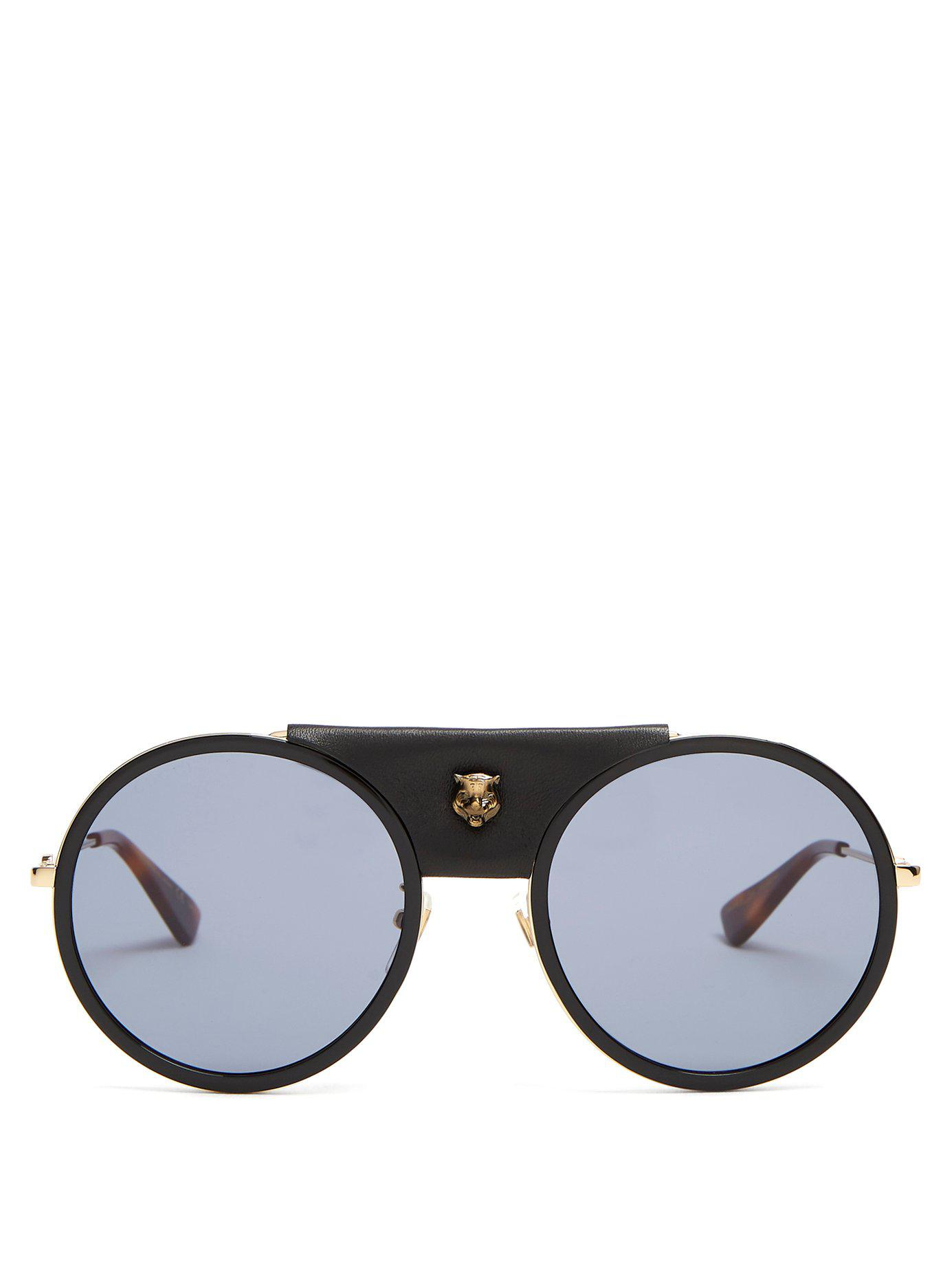 e9bf57adaa7 Lyst - Gucci Round Frame Leather Trimmed Metal Sunglasses in Black ...