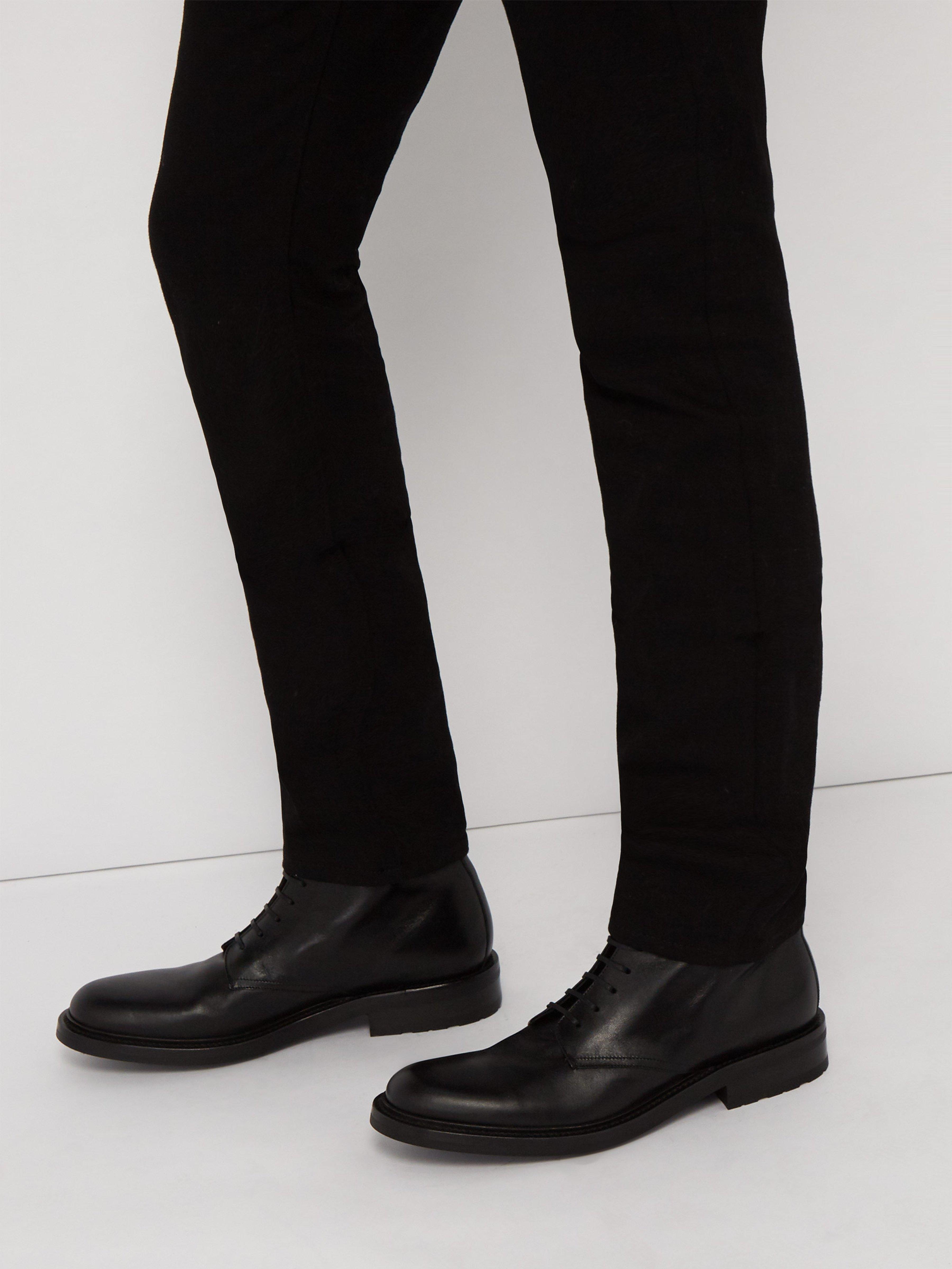 5dc1198c685 ... Saint Laurent Black Army Lace Up Leather Boots for men. Visit  MATCHESFASHION.COM. Tap to visit site
