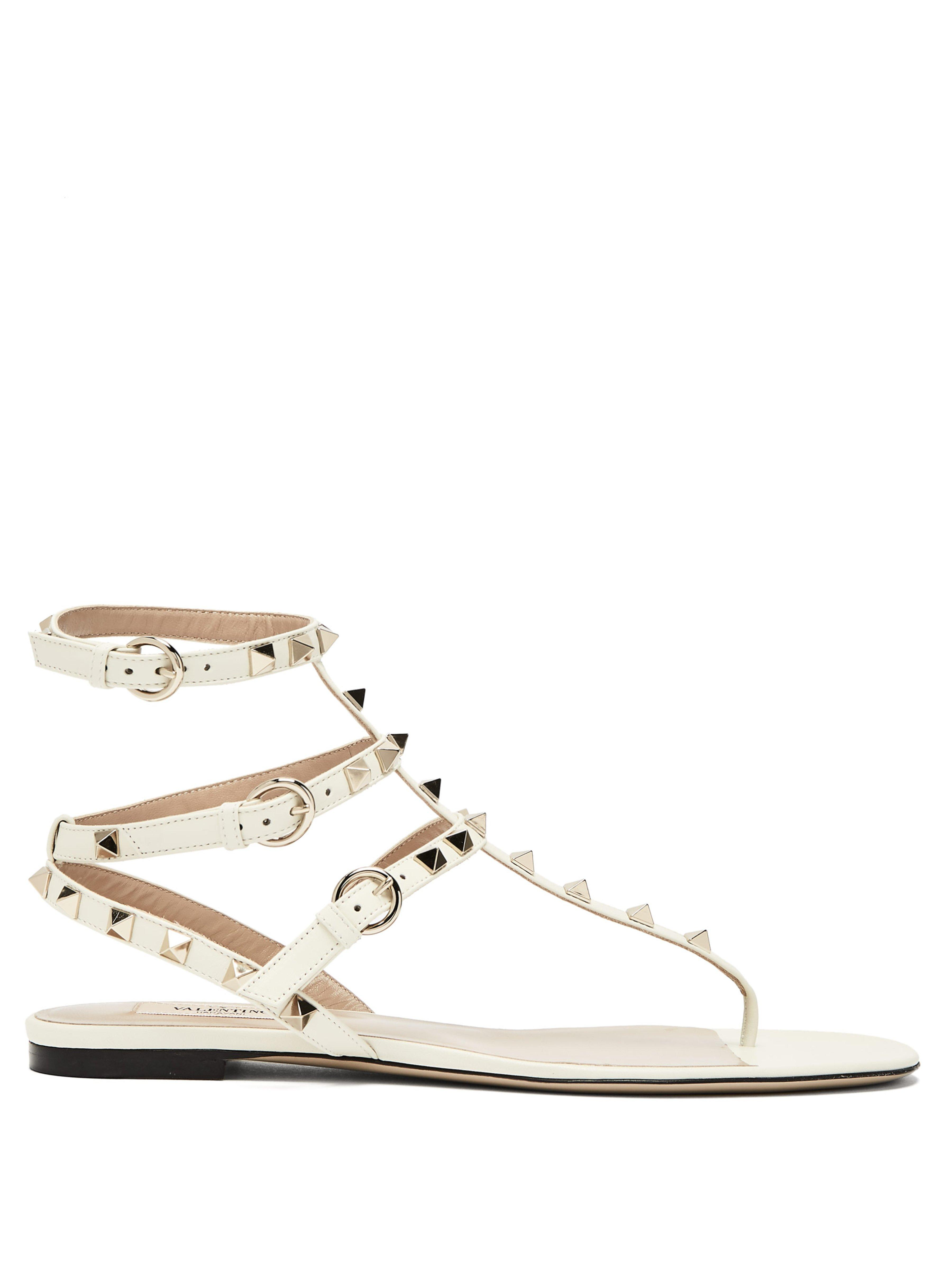 6e183aaabfe Valentino Rockstud Gladiator Leather Sandals in White - Lyst
