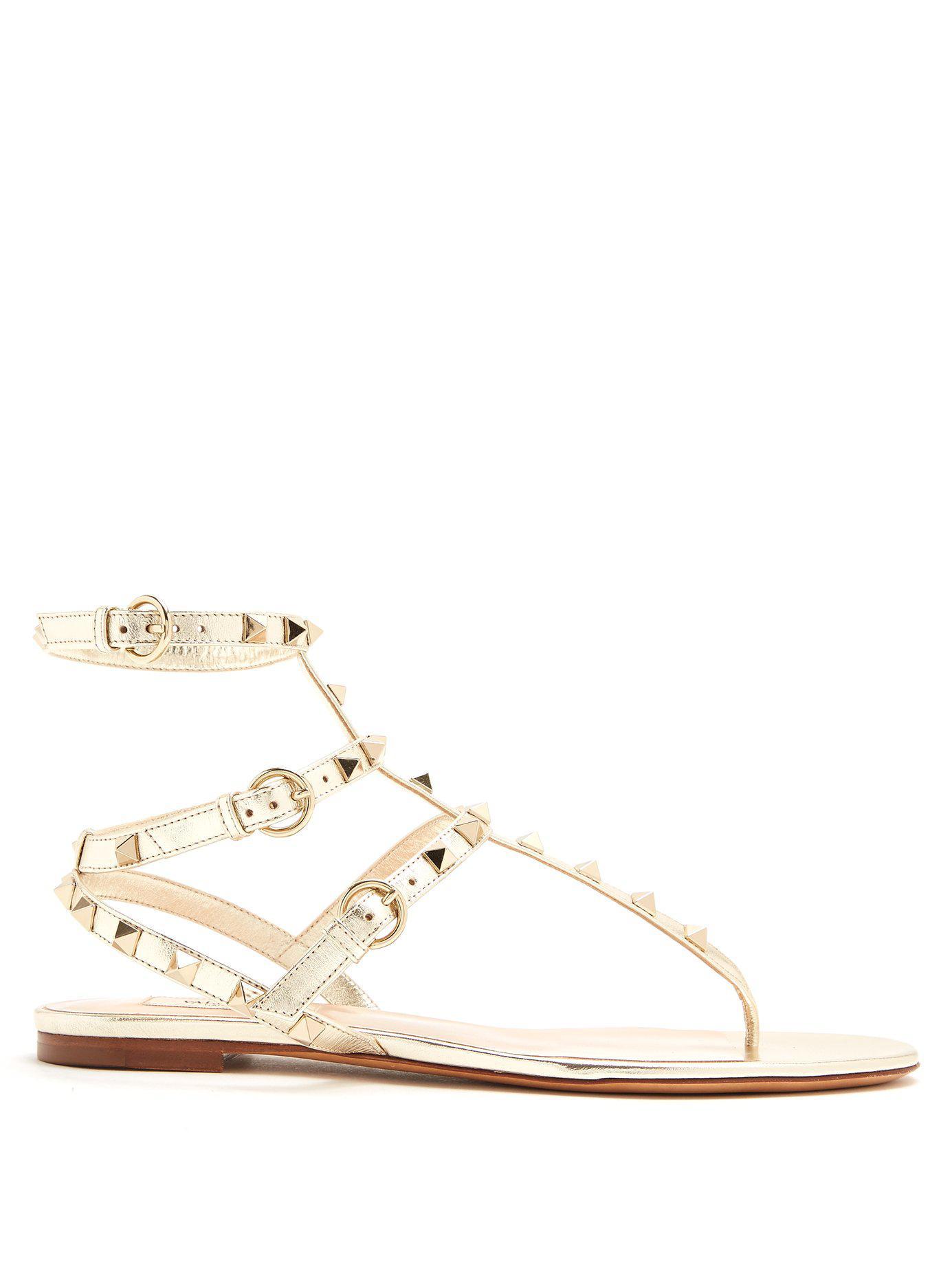 b01f005e5 Valentino - Metallic Rockstud Flat Leather Sandals - Lyst. View fullscreen