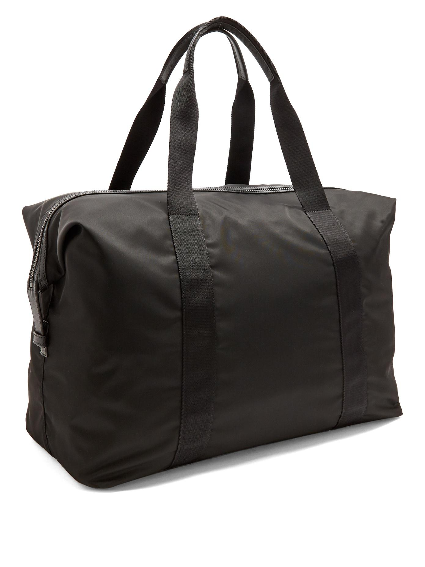 4092ebf11d1f ... inexpensive lyst prada top handle nylon weekend bag in black for men  71e66 d1836