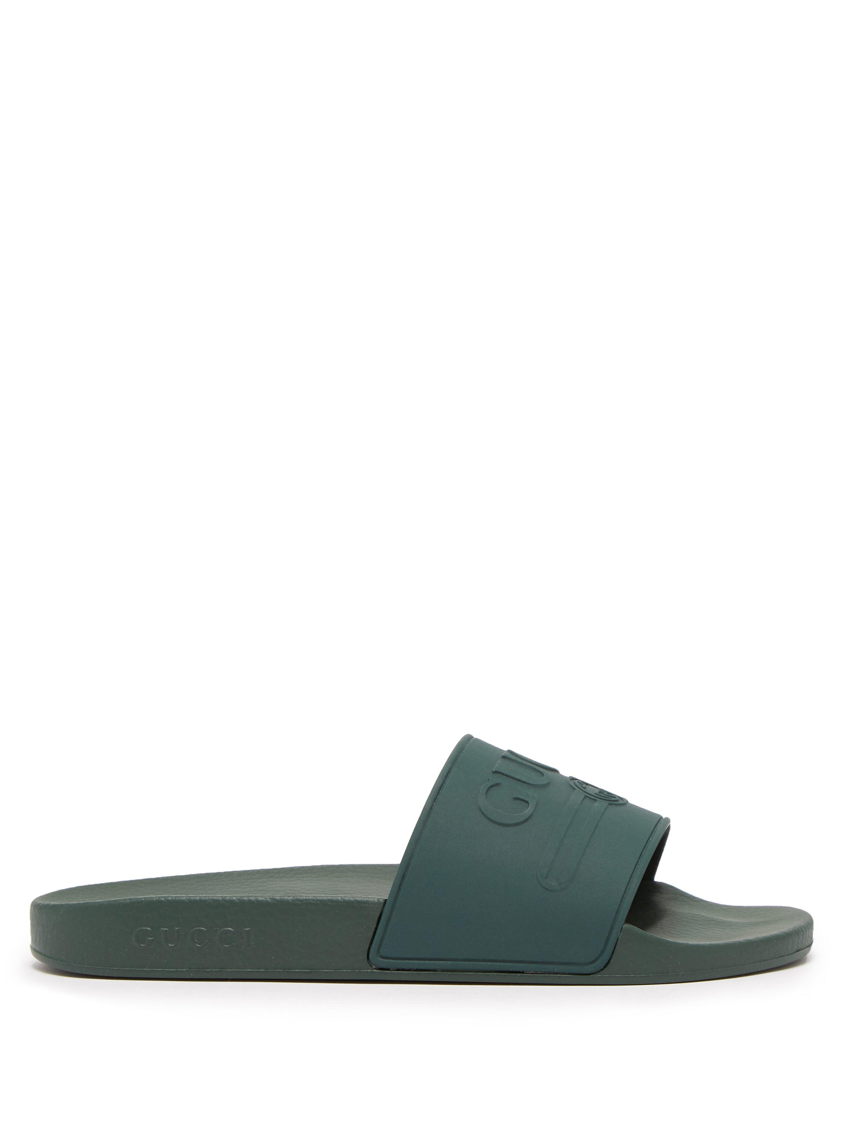 4659fa78a37e Gucci Logo Embossed Rubber Slides in Green for Men - Lyst