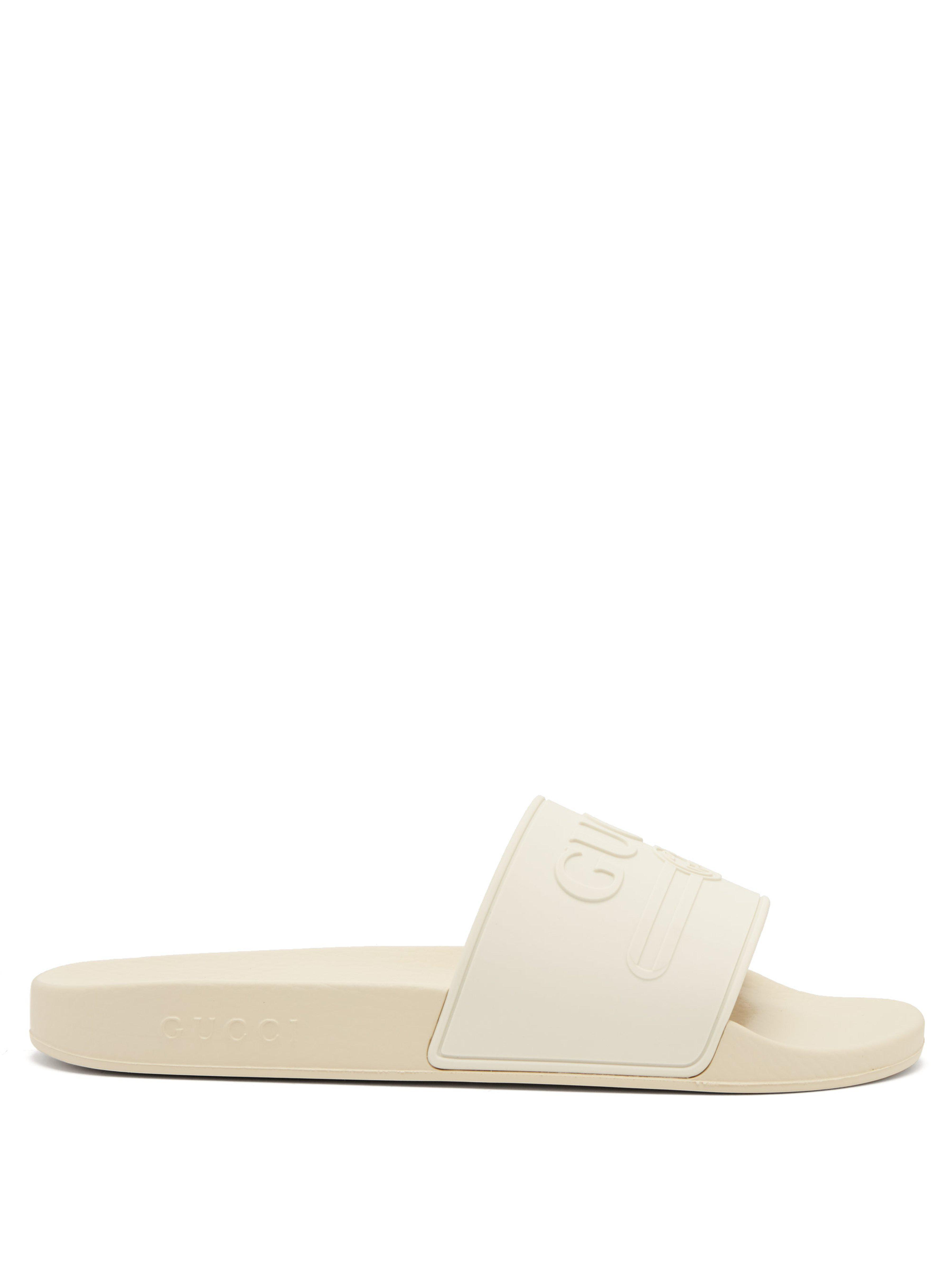 3ccd7dc53ad5 Gucci Logo Embossed Rubber Slides in White for Men - Lyst
