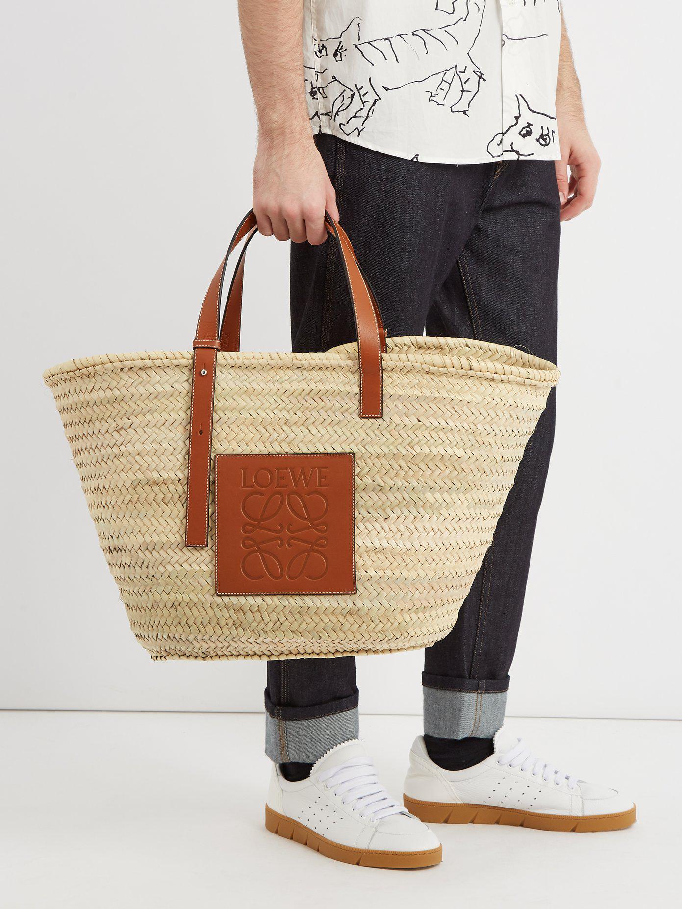 7ce3e60c13c Loewe Leather-trimmed Logo-debossed Raffia Basket Bag - Lyst