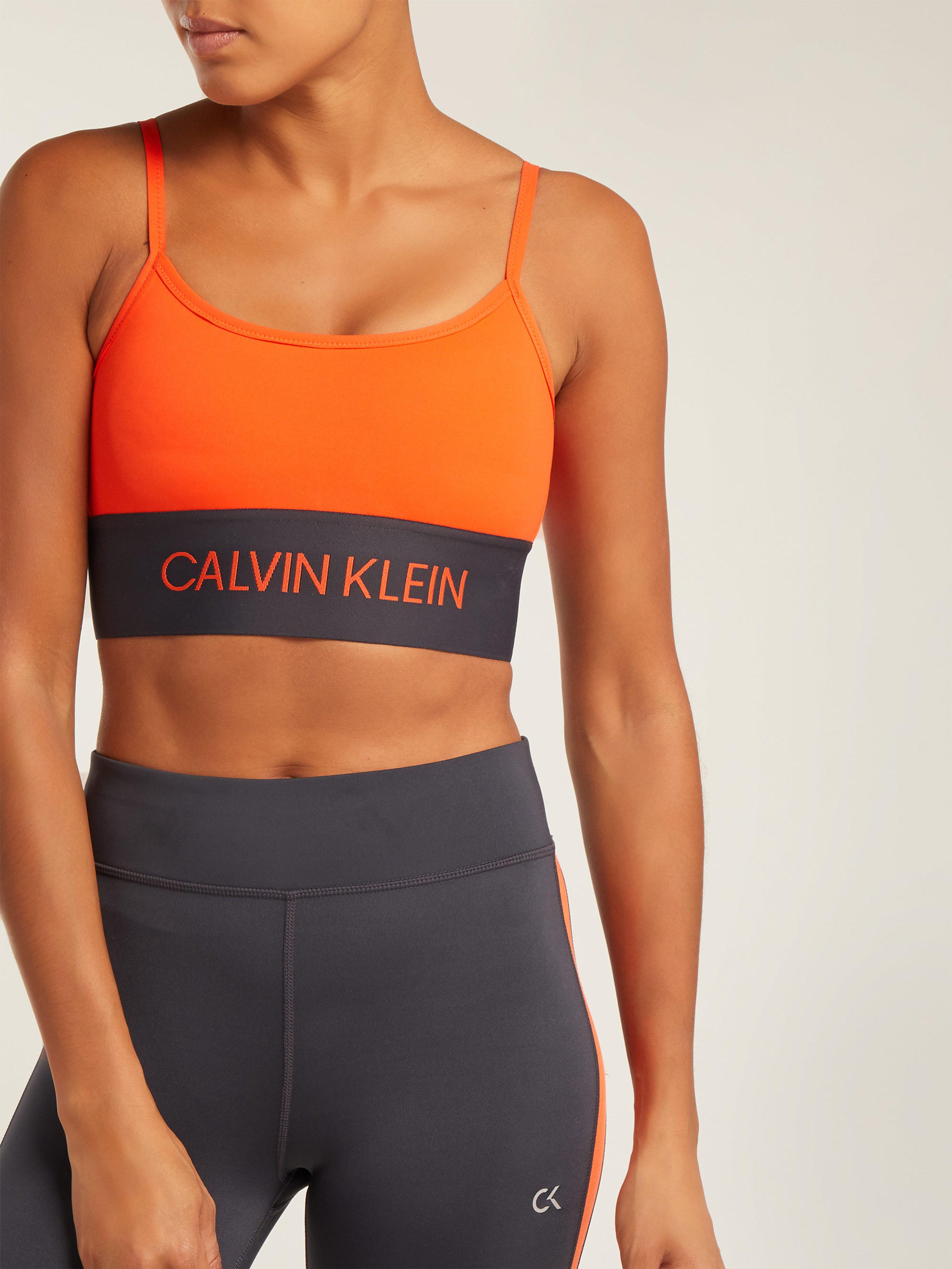 cd038de2a4e Calvin Klein Logo Jacquard Sports Bra in Orange - Save 40% - Lyst