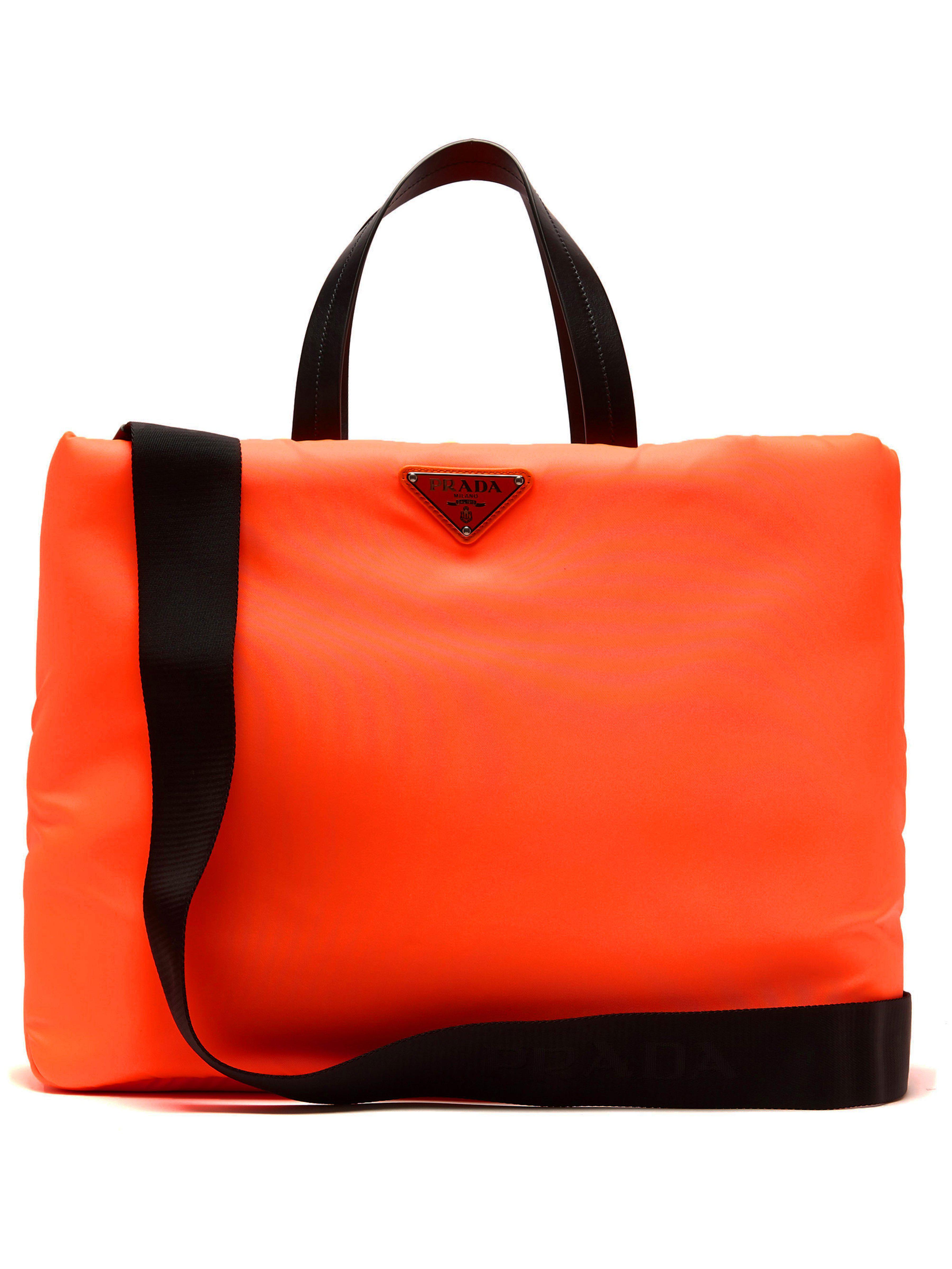bb2202af415d Prada Logo Embellished Padded Nylon Tote Bag in Orange - Lyst