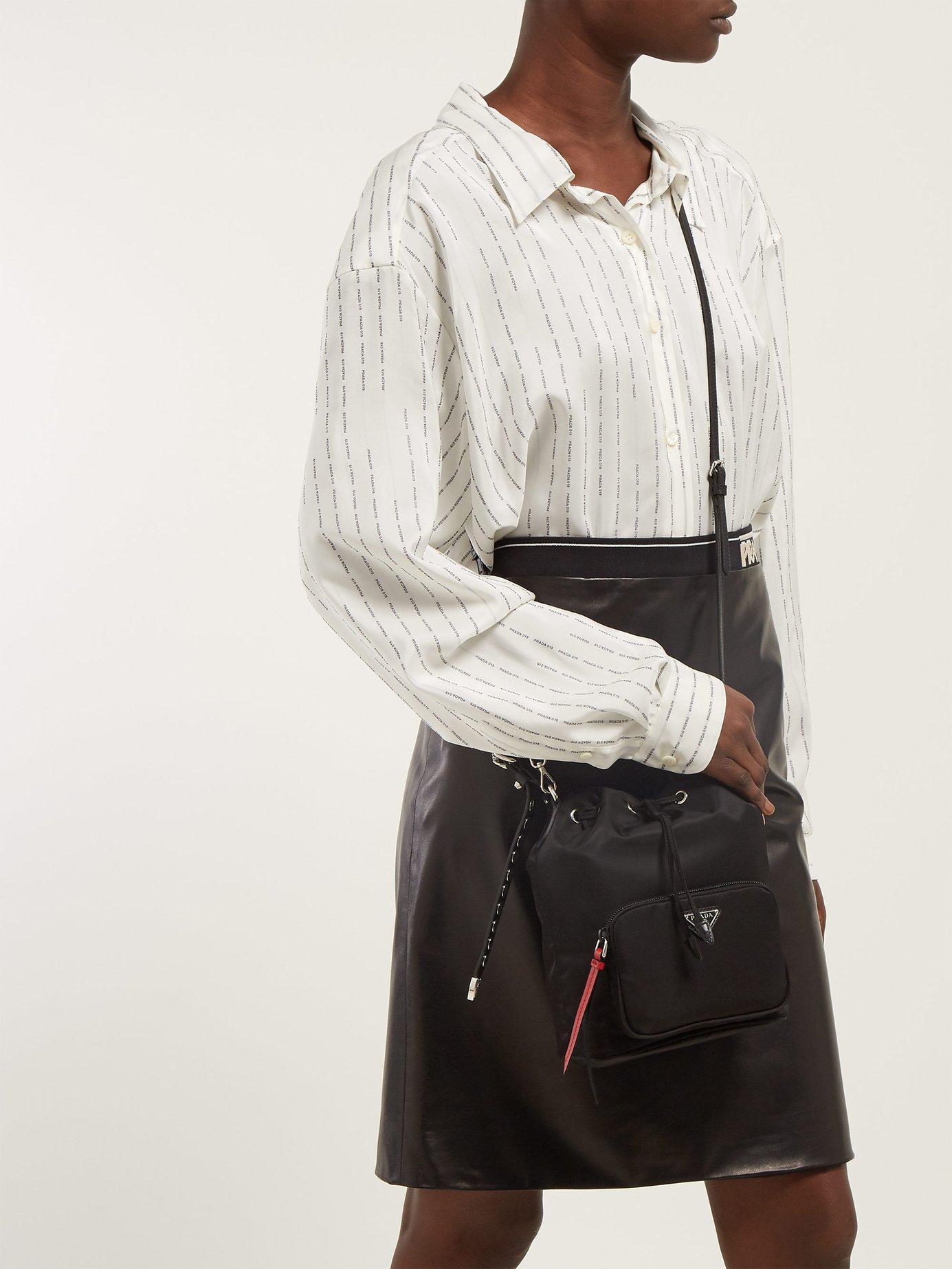 bd04d34d03ed01 Prada New Vela Studded Nylon Bucket Bag in Black - Lyst