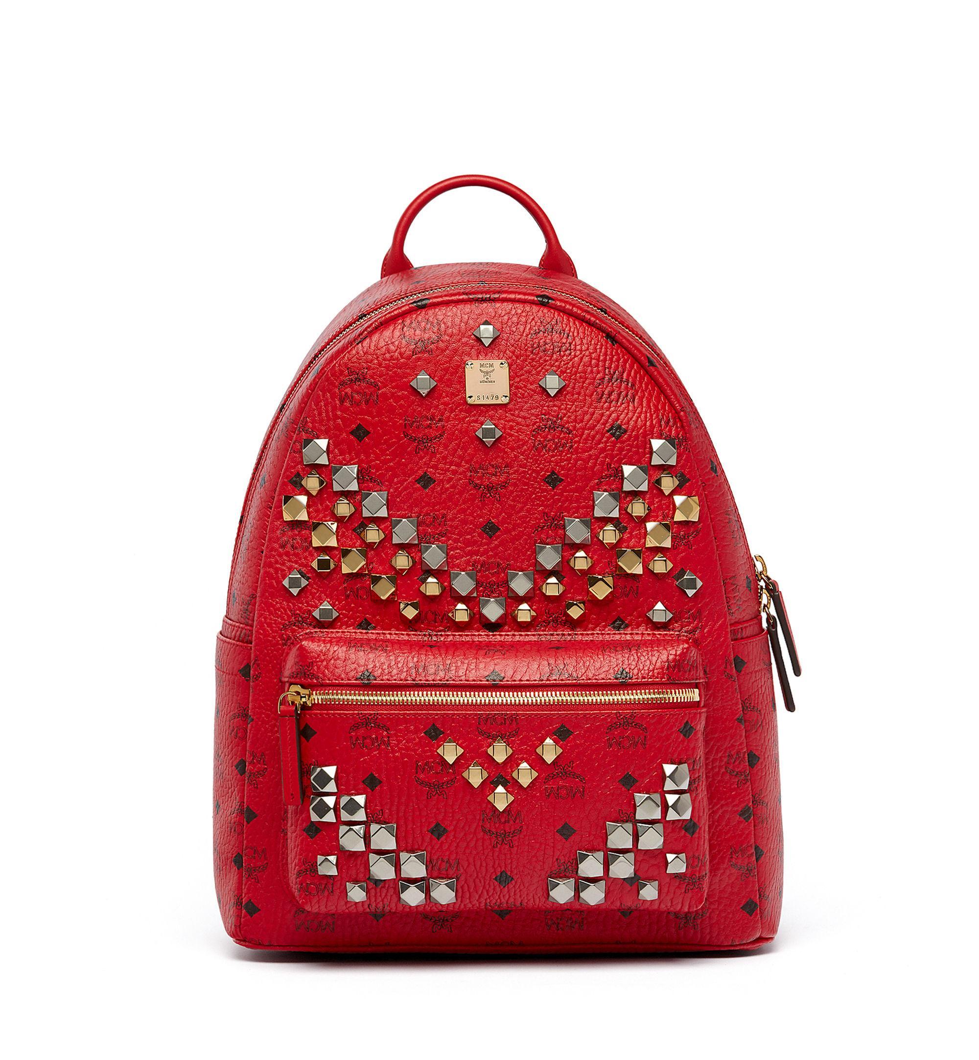 mcm stark m studded medium canvas backpack in red lyst. Black Bedroom Furniture Sets. Home Design Ideas