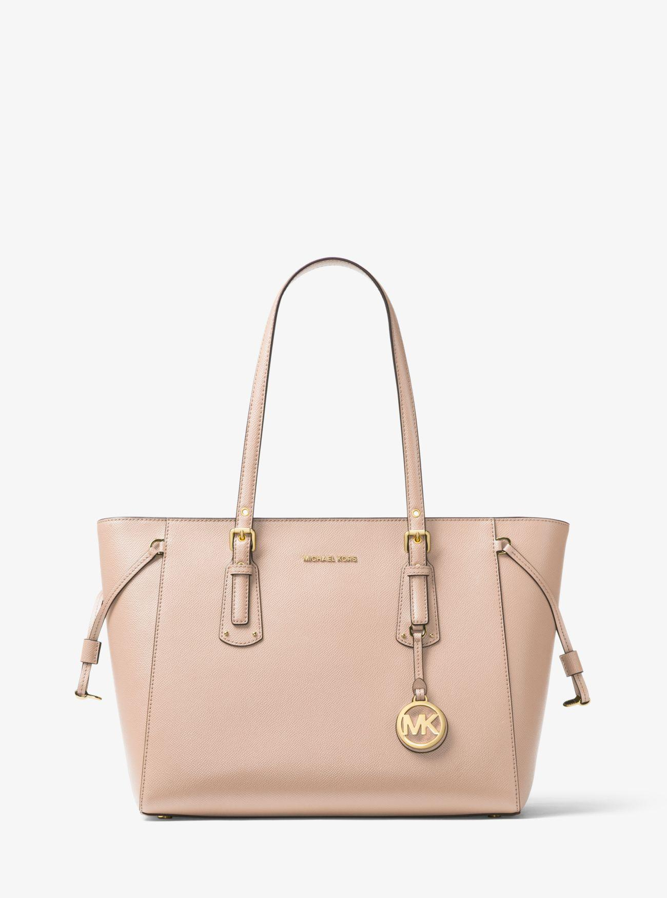 8854e8089bce Michael Kors - Pink Voyager Medium Leather Tote - Lyst. View fullscreen