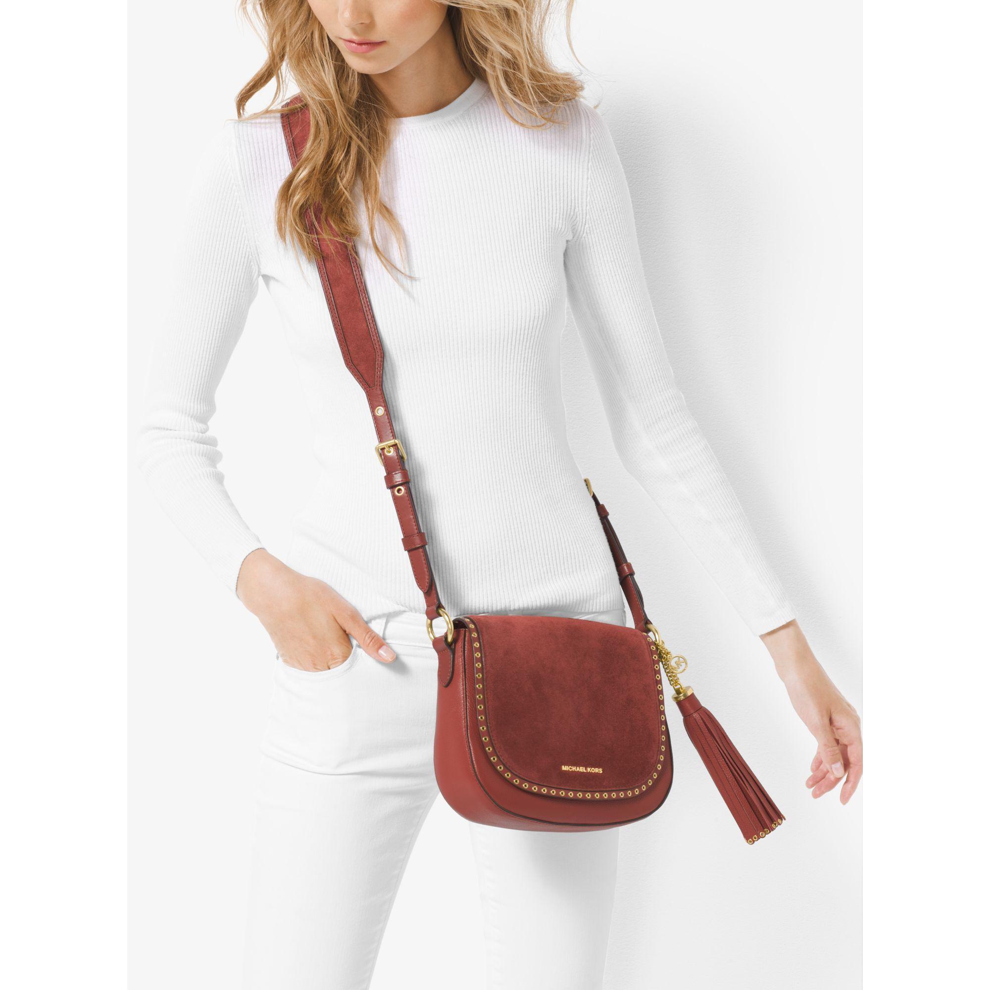 153dcc3ce14b Lyst - Michael Kors Brooklyn Medium Saddle Bag in Red