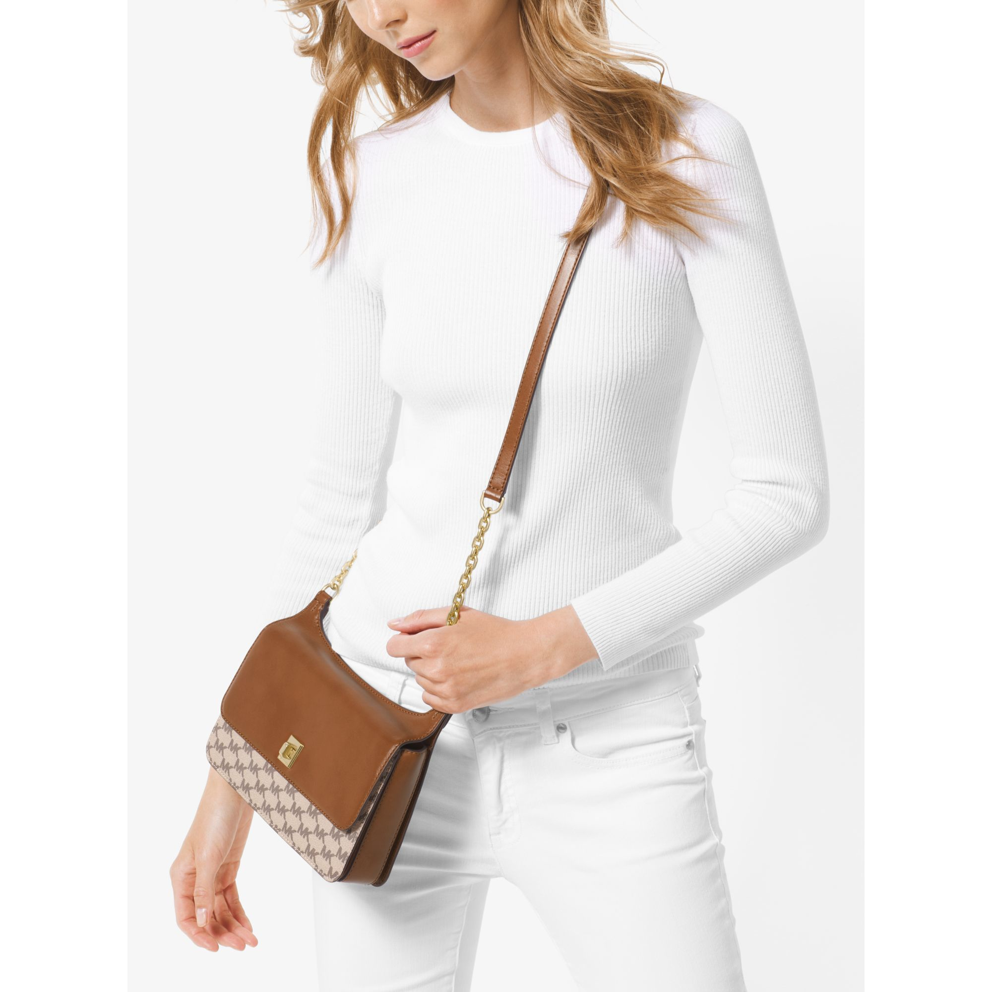 dd2451674bf7 Lyst - Michael Kors Natalie Medium Heritage Signature Messenger in ...