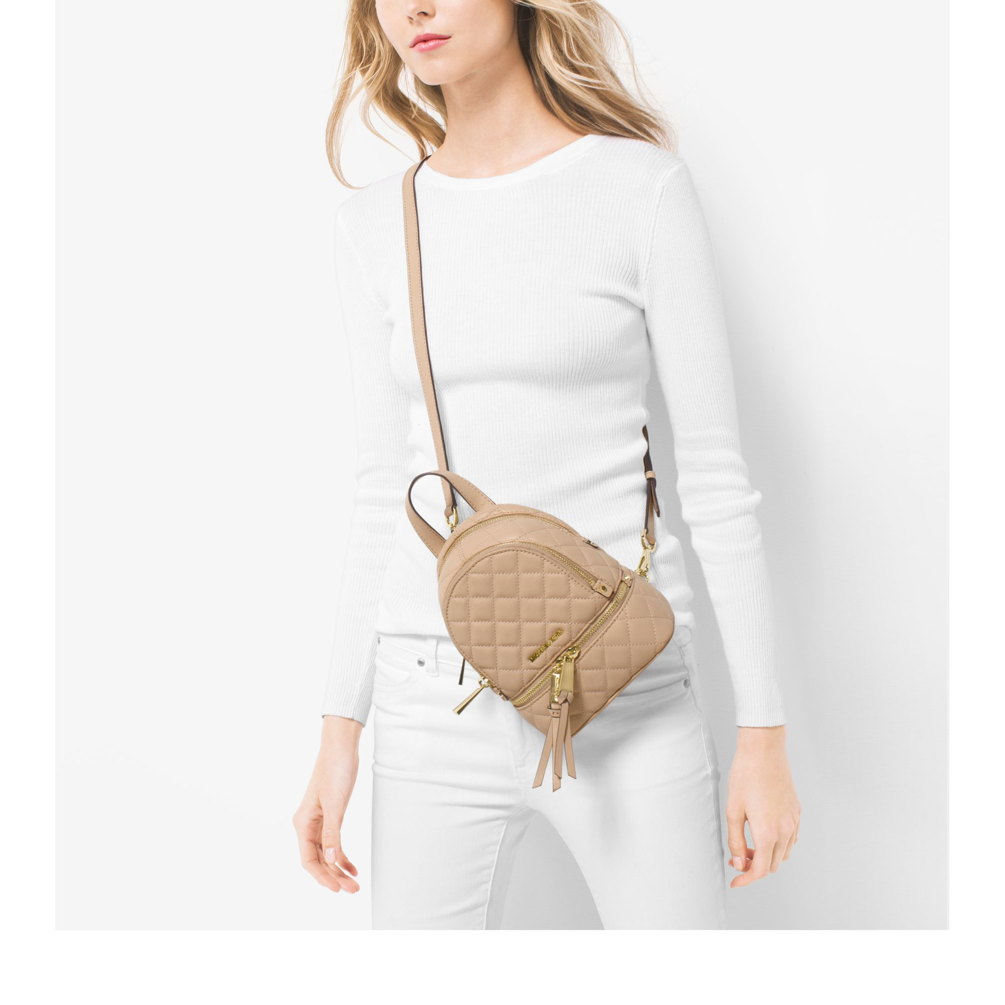 74a1a8a8f11a Lyst - Michael Kors Rhea Extra-small Quilted-leather Backpack in Natural