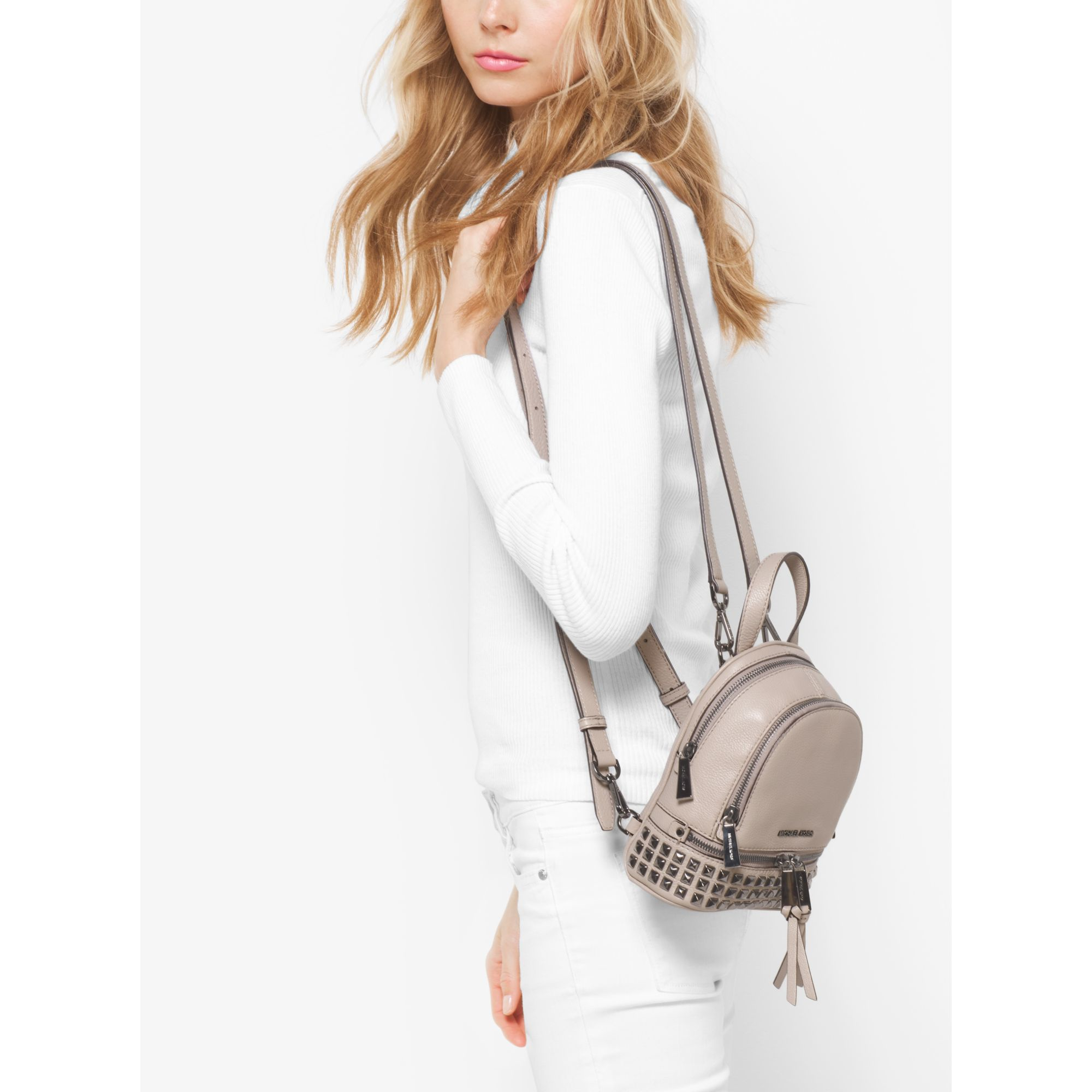 230d6e750476 ... italy backpack lyst michael kors rhea extra small studded leather  backpac 65fb1 0c5c0