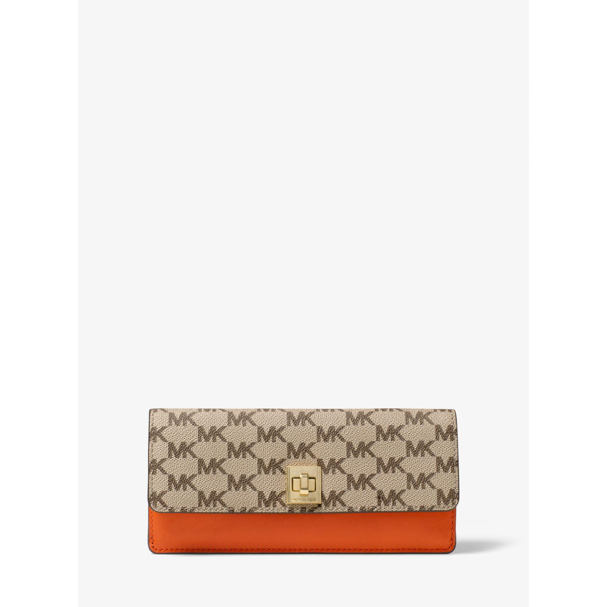 56e7953ec8e0 Lyst - Michael Kors Natalie Heritage Signature Logo Wallet in Orange