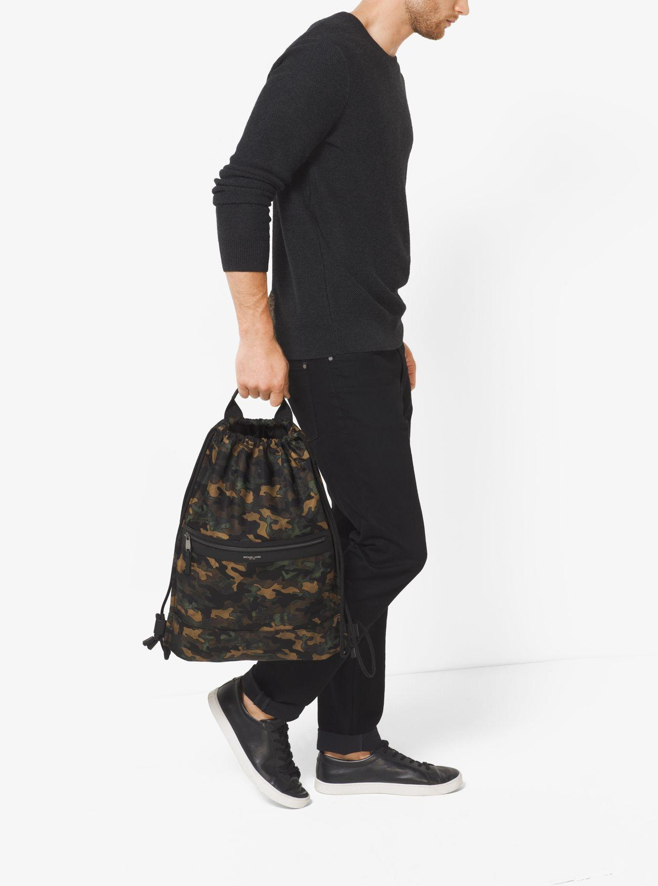 4a59e9737721 ... Michael kors Kent Camouflage Nylon Drawstring Backpack in Bl ...