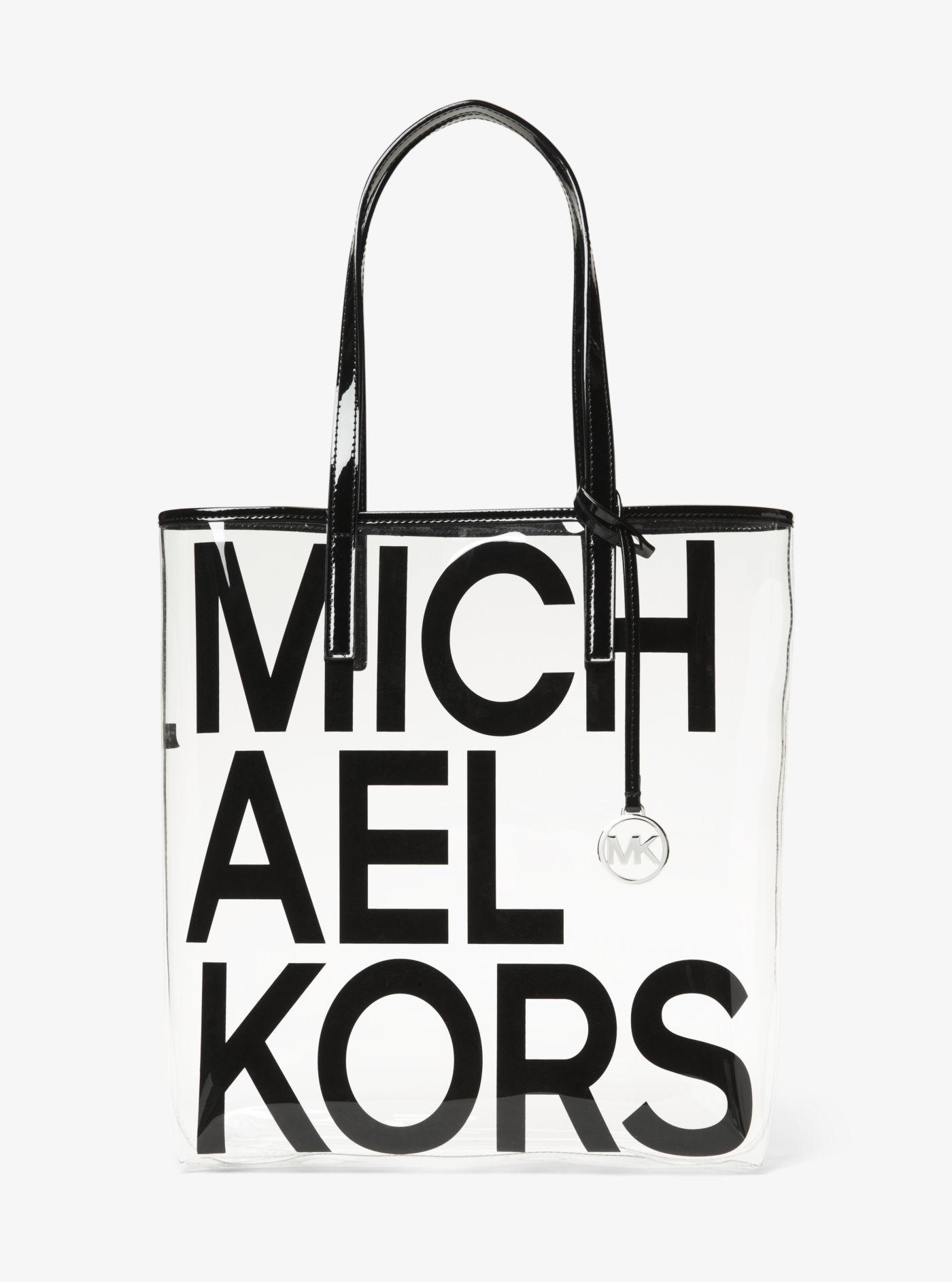 1e768a12df42 ... get michael kors black the michael large graphic logo print clear tote  lyst. view fullscreen