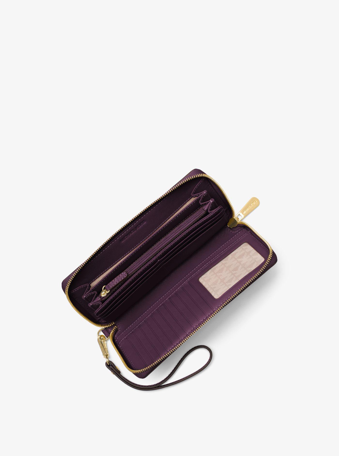 99927b81bd33 Lyst - Michael Kors Leather Continental Wristlet in Purple