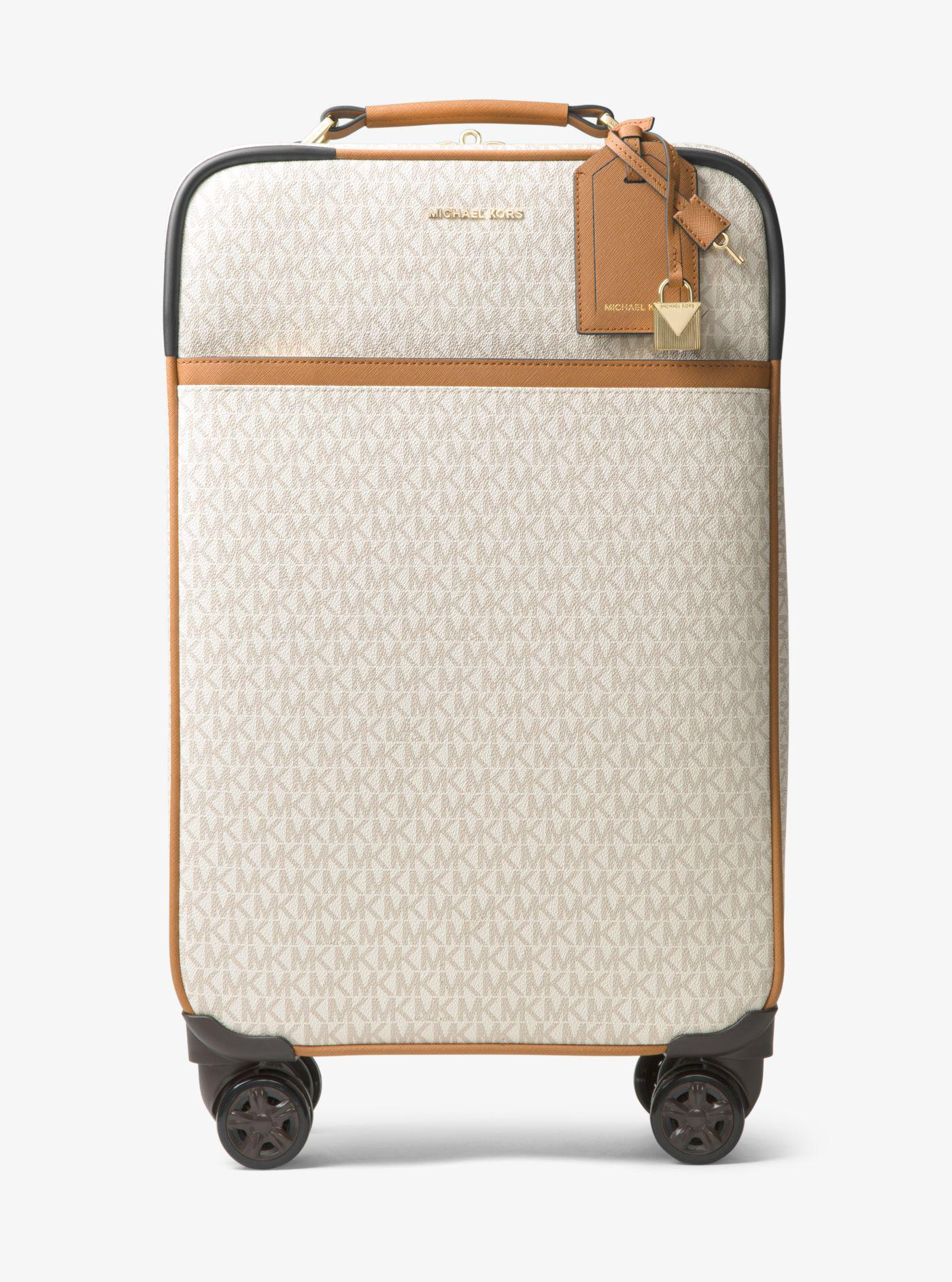 4ef9bb5d7a2a ... wholesale lyst michael kors jet set travel logo suitcase 06cb8 ea5be