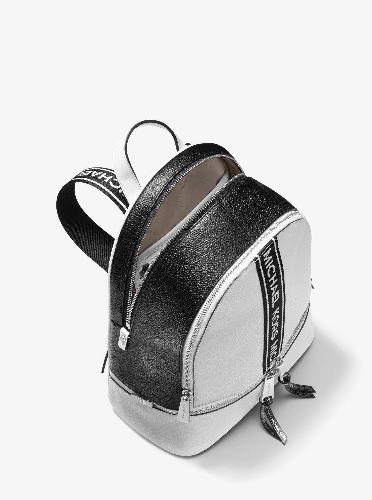 1828a181ec7b Michael Kors - White Rhea Medium Logo Tape Backpack - Lyst. View fullscreen