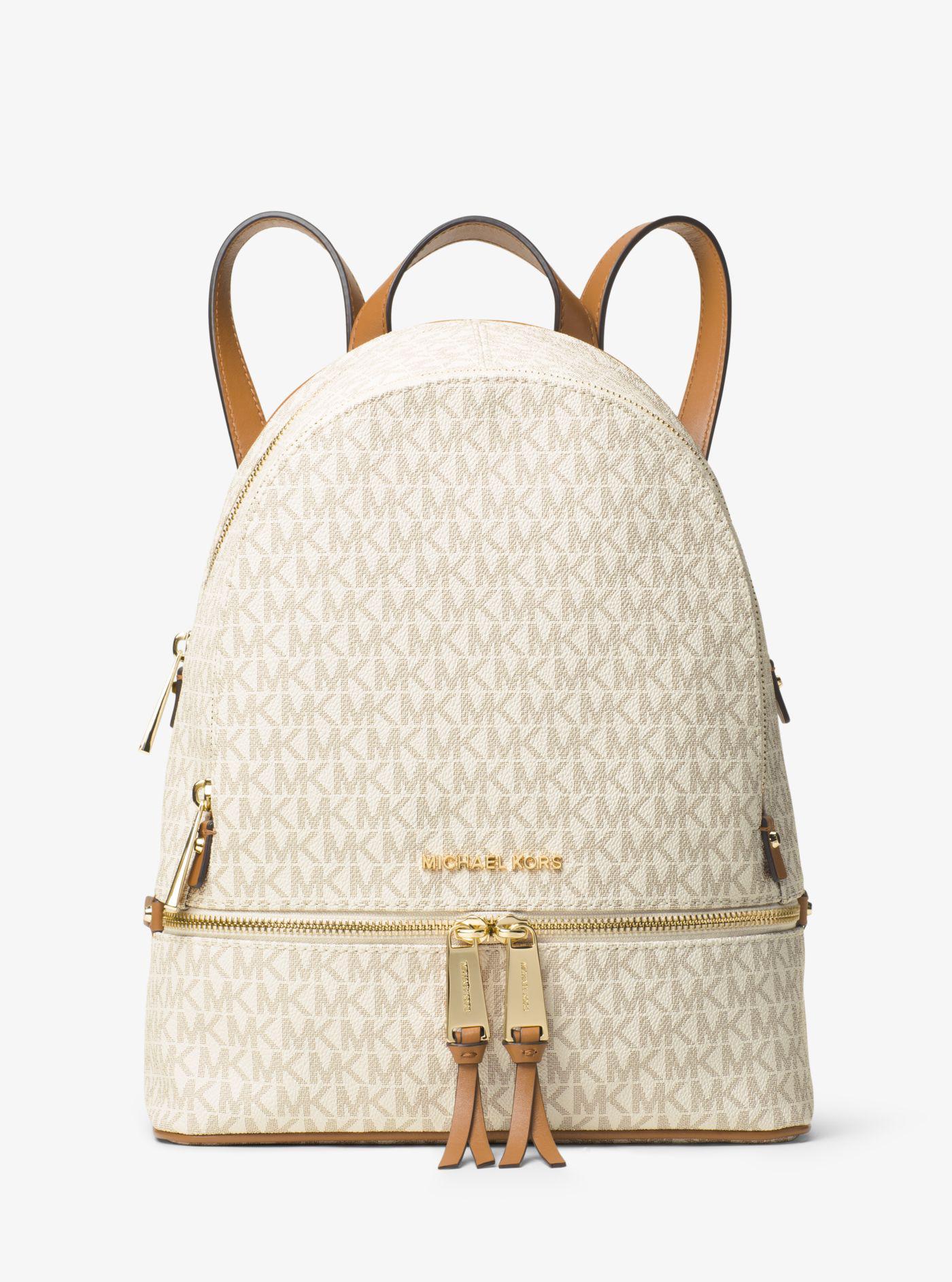 bdfddb353907 Lyst - Michael Kors Rhea Medium Backpack in Natural - Save 27%