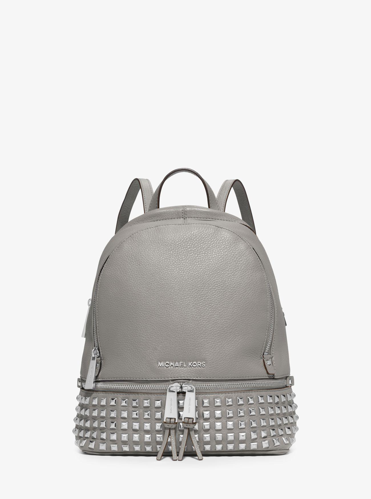 ac317ec99 Tap to visit site. Michael Kors - White Rhea Medium Studded Pebbled Leather  Backpack ...