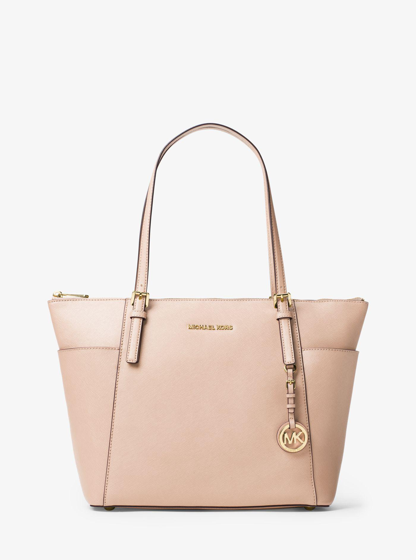 f6e743fba9d844 Michael Kors - Pink Jet Set Large Top-zip Saffiano Leather Tote - Lyst.  View fullscreen
