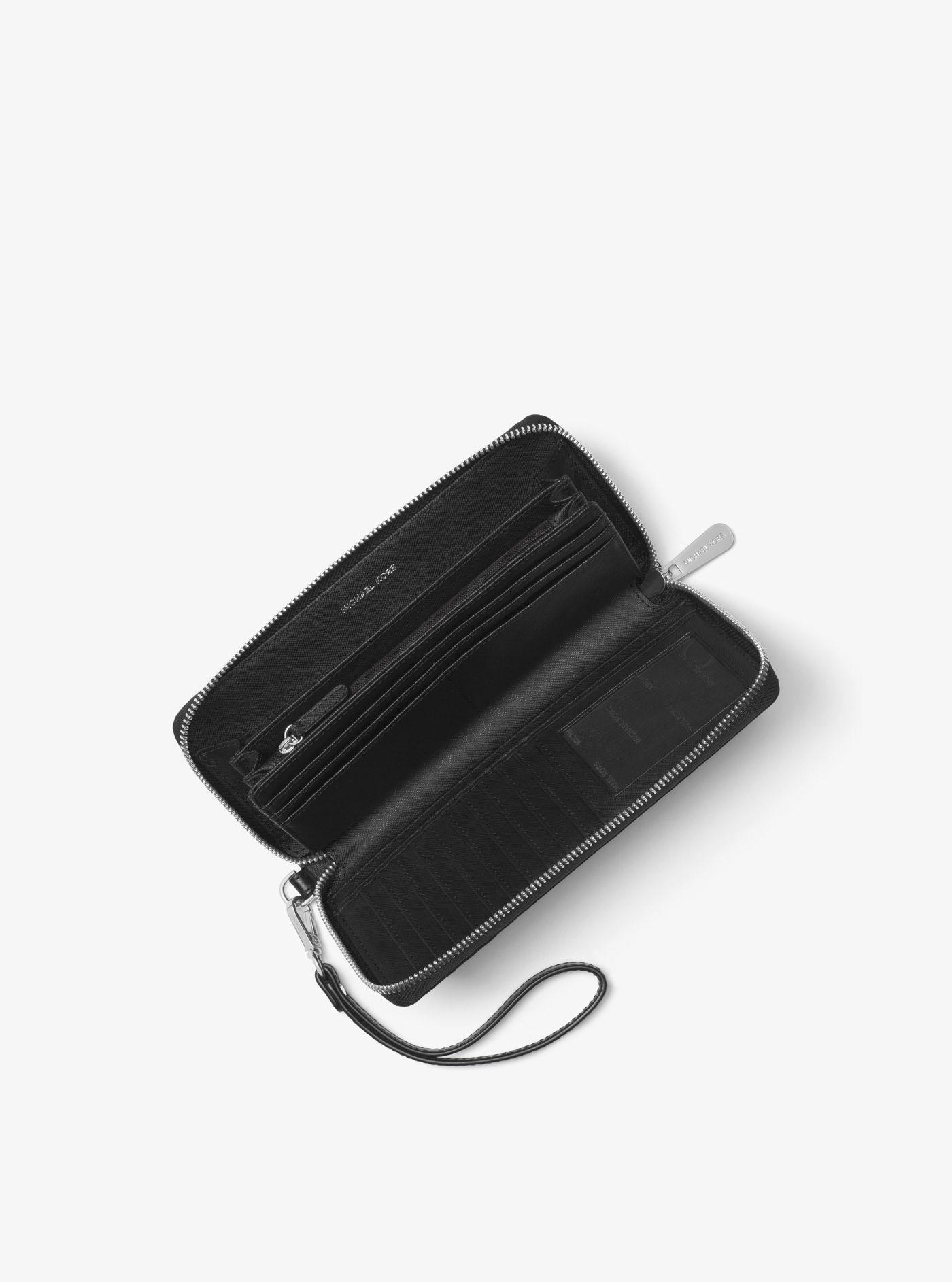 dfd753318630 Michael Kors - Black Logo Continental Wristlet - Lyst. View fullscreen