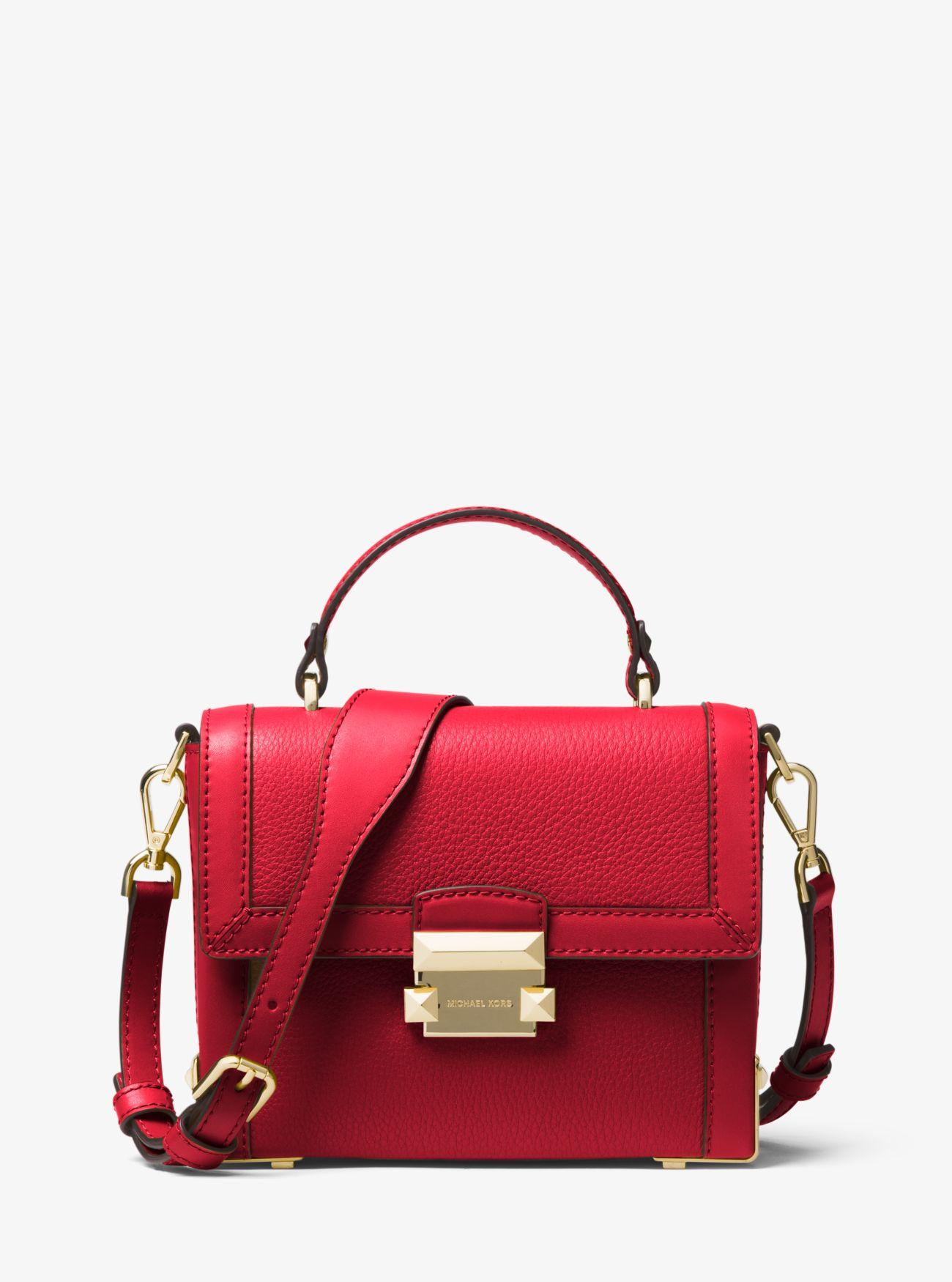 c84087182102 Lyst - MICHAEL Michael Kors Jayne Small Pebbled Leather Trunk Bag in Red