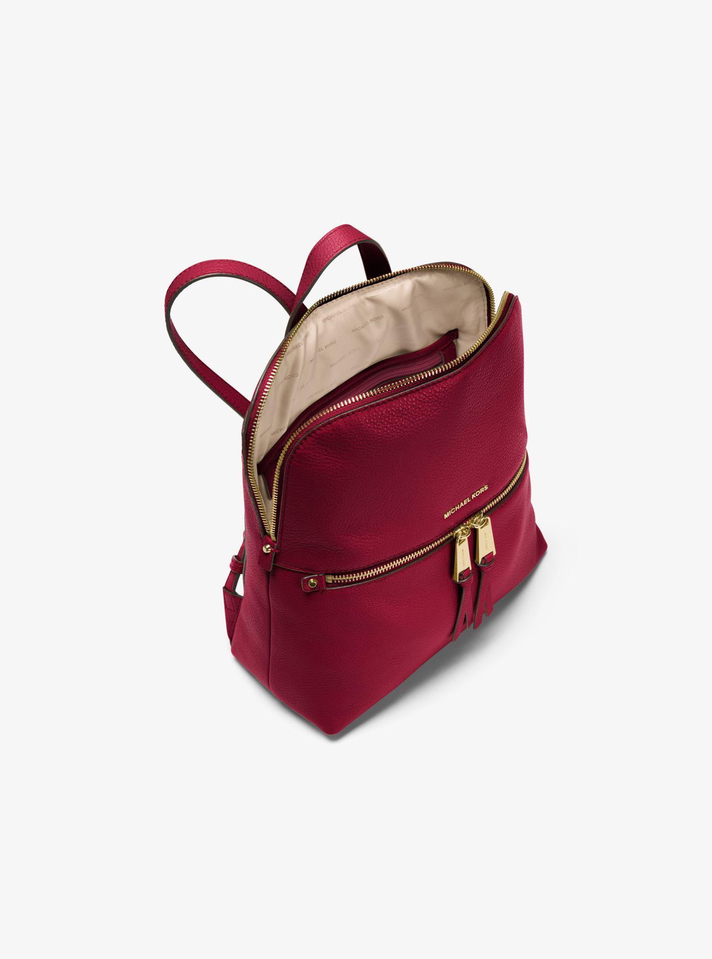 33d79917ea6358 Michael Kors Rhea Medium Slim Leather Backpack in Red - Lyst