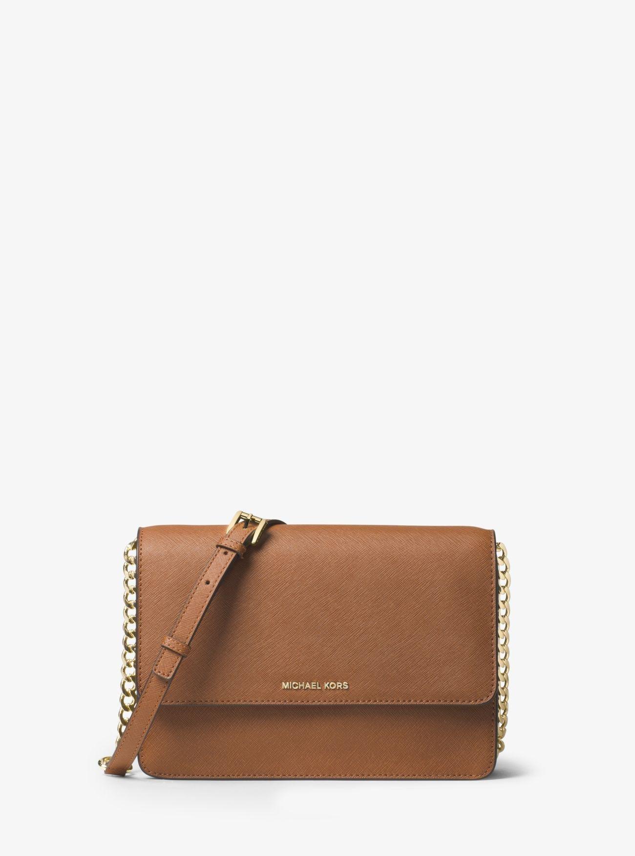 0eb9f070b567 Lyst - Michael Kors Daniela Large Leather Crossbody in Brown