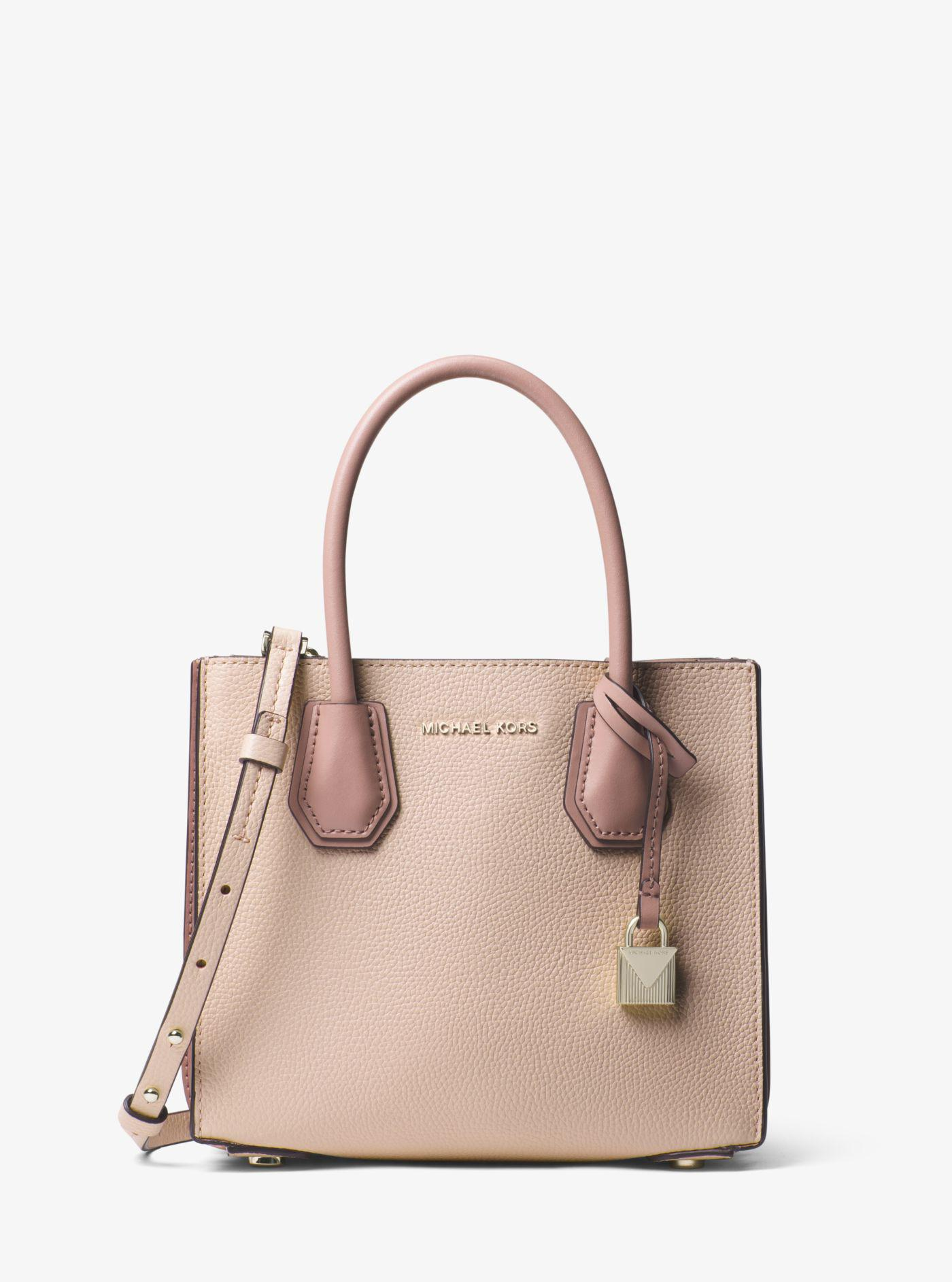 7e98f6266b8 Michael Kors - Pink Mercer Pebbled Leather Accordion Crossbody - Lyst. View  fullscreen