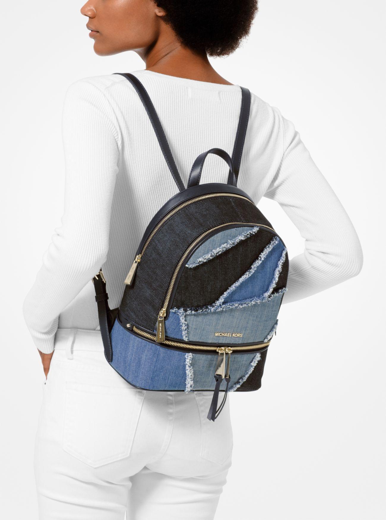 620f00631bfe67 MICHAEL Michael Kors - Blue Rhea Medium Frayed Denim Backpack - Lyst. View  fullscreen