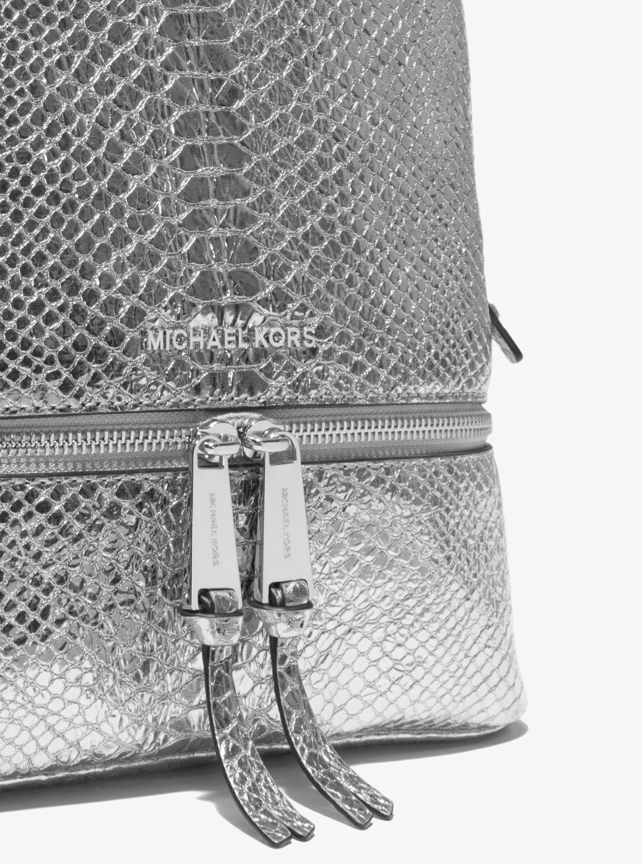eb38b0518827 Lyst - Michael Kors Rhea Medium Metallic Embossed-leather Backpack ...