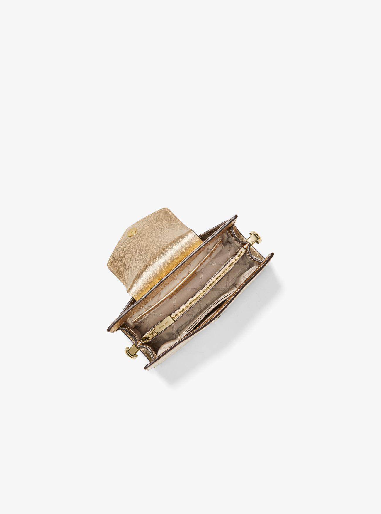 42985e7f616a Michael Kors - Medium Metallic Crossgrain Leather Crossbody Clutch - Lyst.  View fullscreen