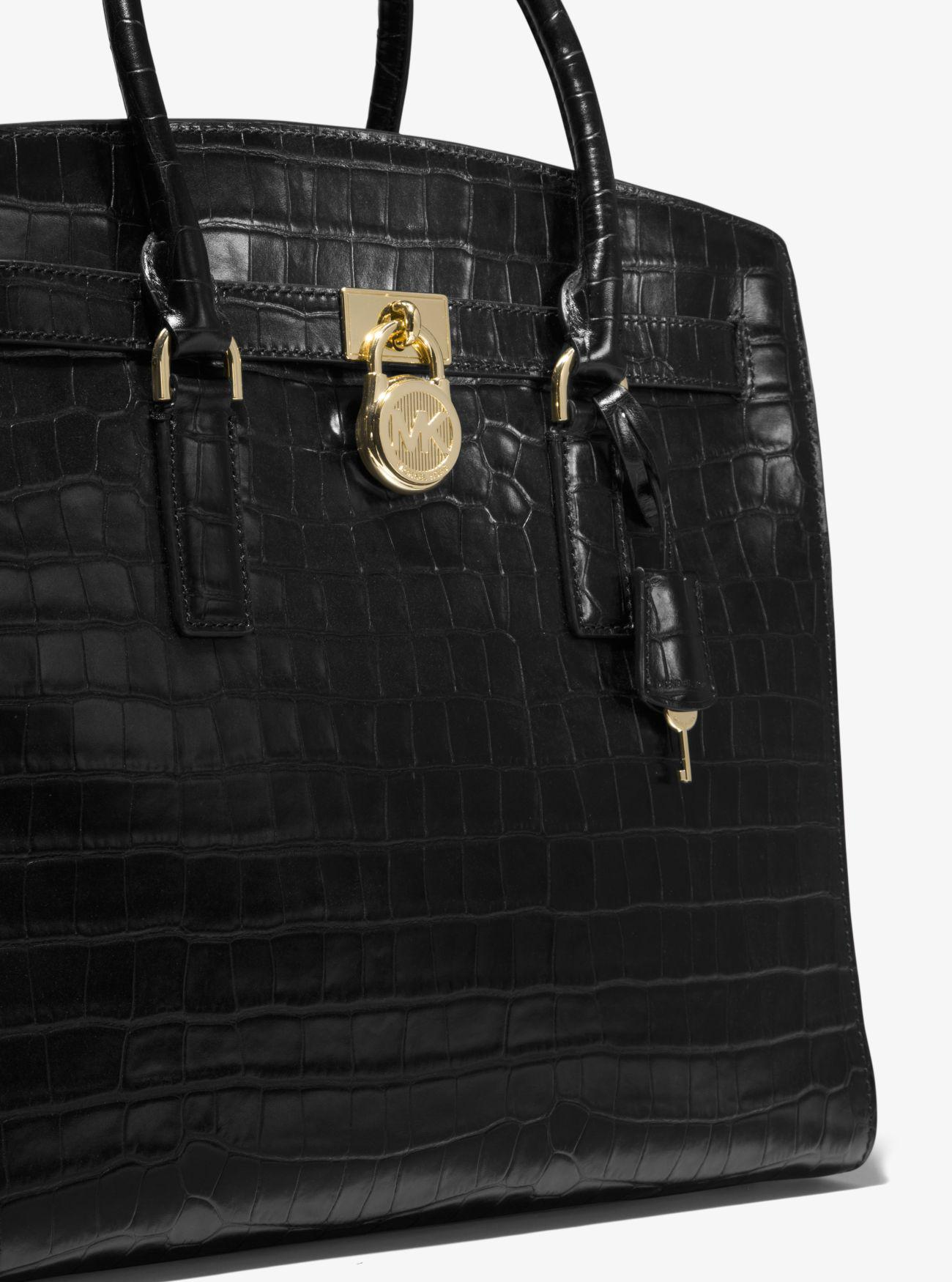 3047d4ca72d0 ... low price lyst michael kors hamilton embossed leather weekender in black  d6daa be3a0