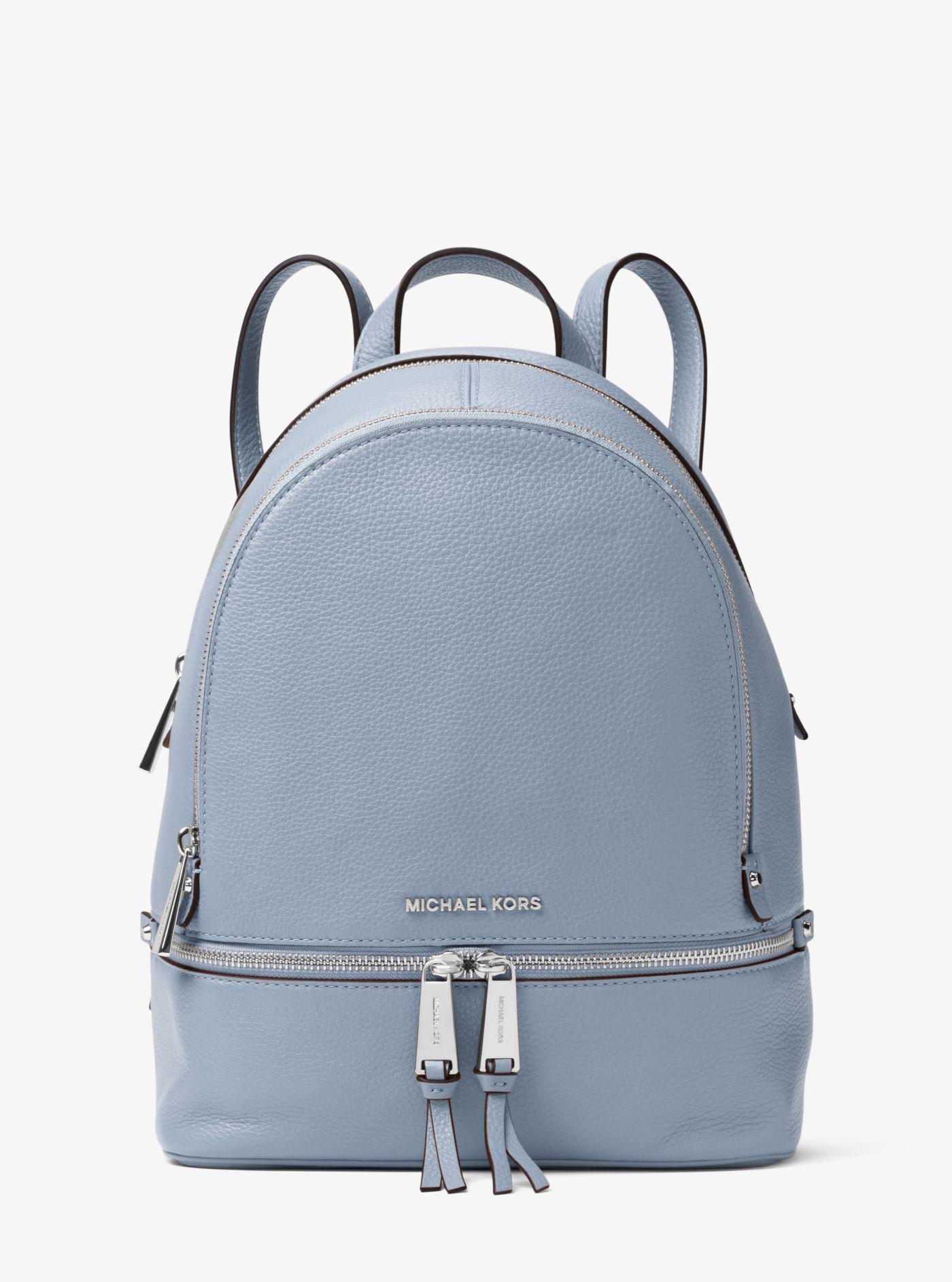 1516175a5a9c clearance michael kors blue rhea medium leather backpack lyst. view  fullscreen 05196 6d6a2
