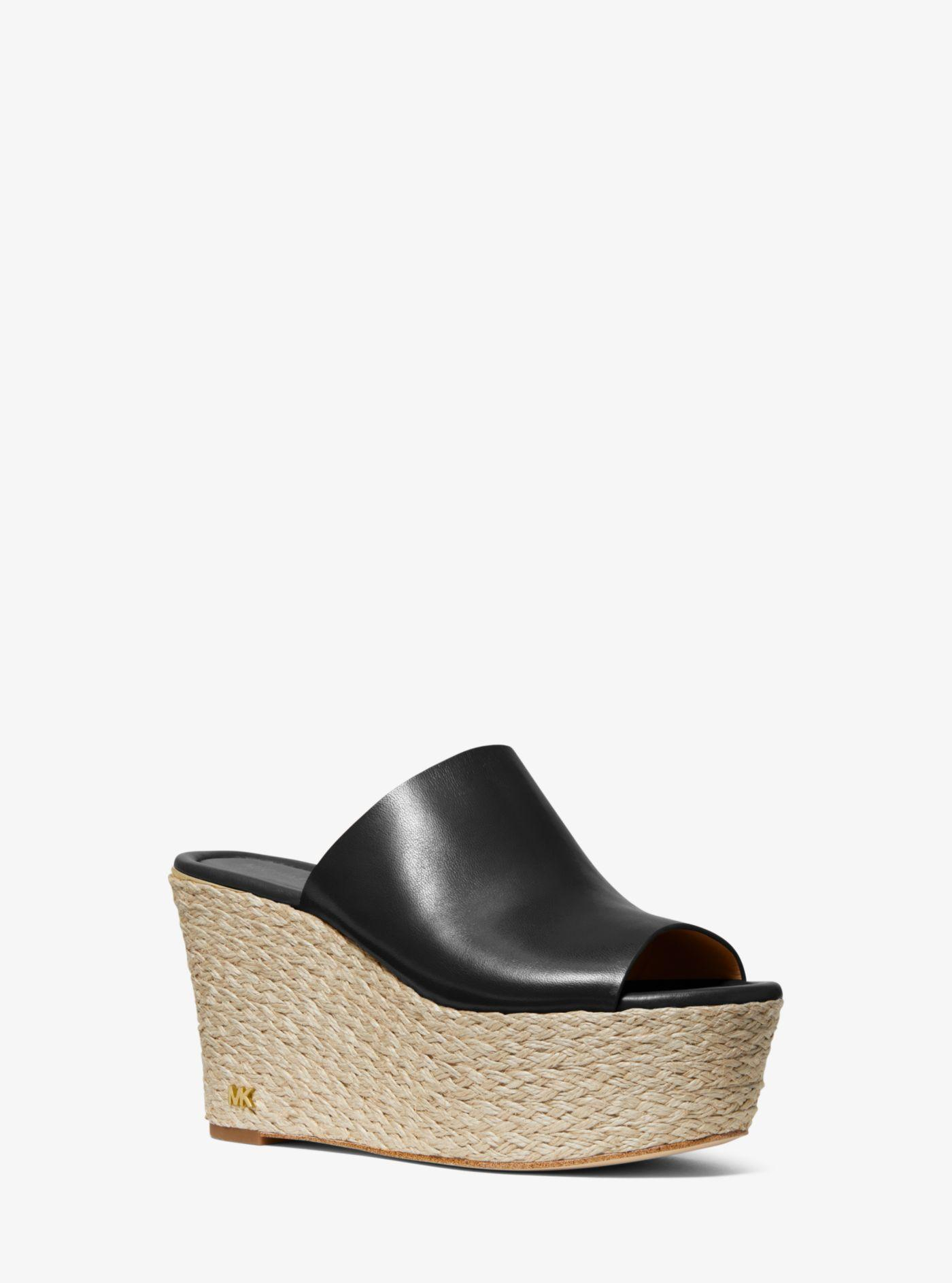 e14905a57585 Lyst - Michael Kors Cunningham Leather Wedge in Black