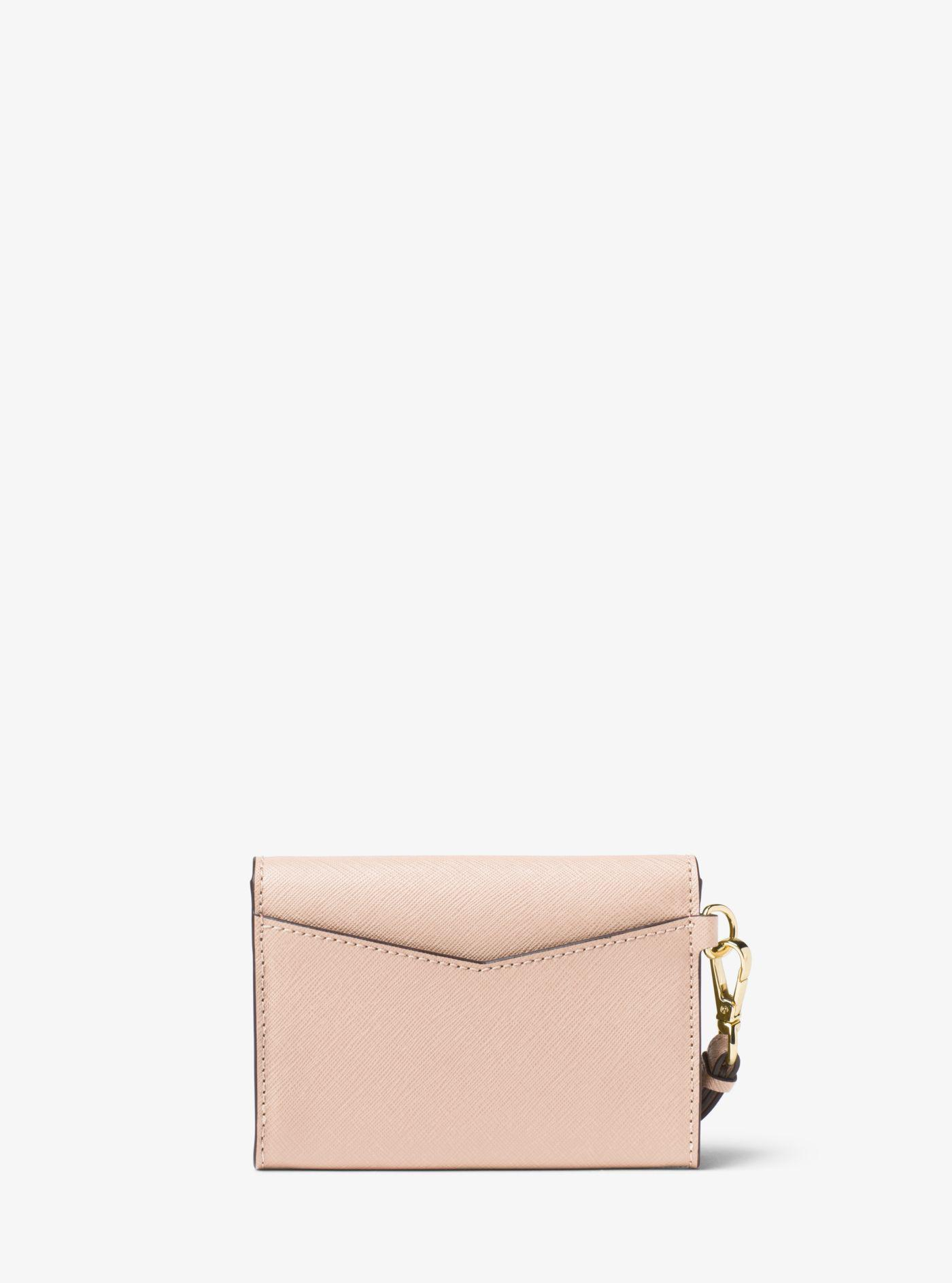 82a5390e3bc6 Lyst - Michael Kors Honey Medium Leather Wristlet in Pink