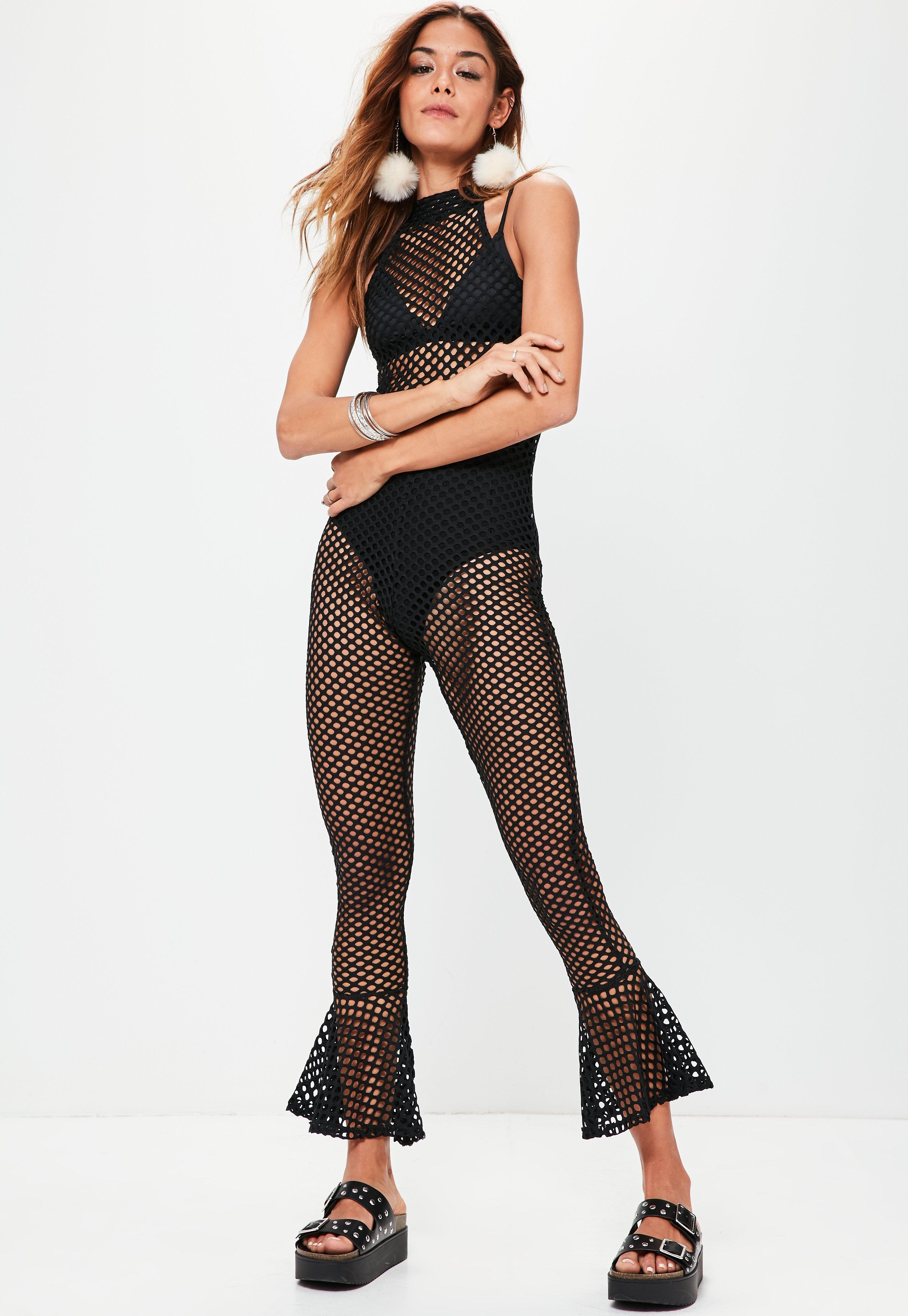 be973cfa45 Lyst - Missguided Black Flared Ankle Fishnet Jumpsuit in Black