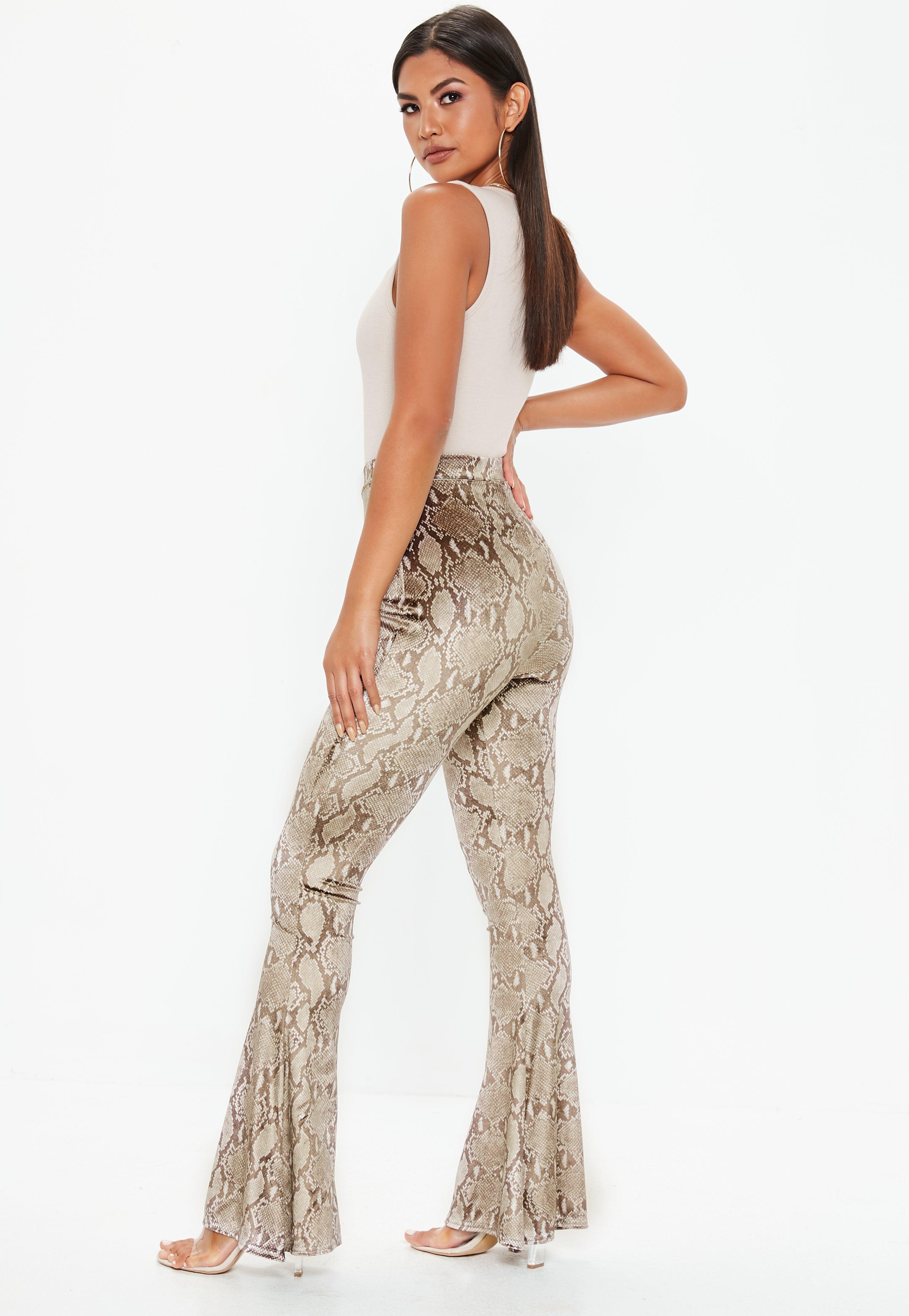 408653e093c Missguided - Brown Snake Print Velvet Flare Trousers - Lyst. View fullscreen
