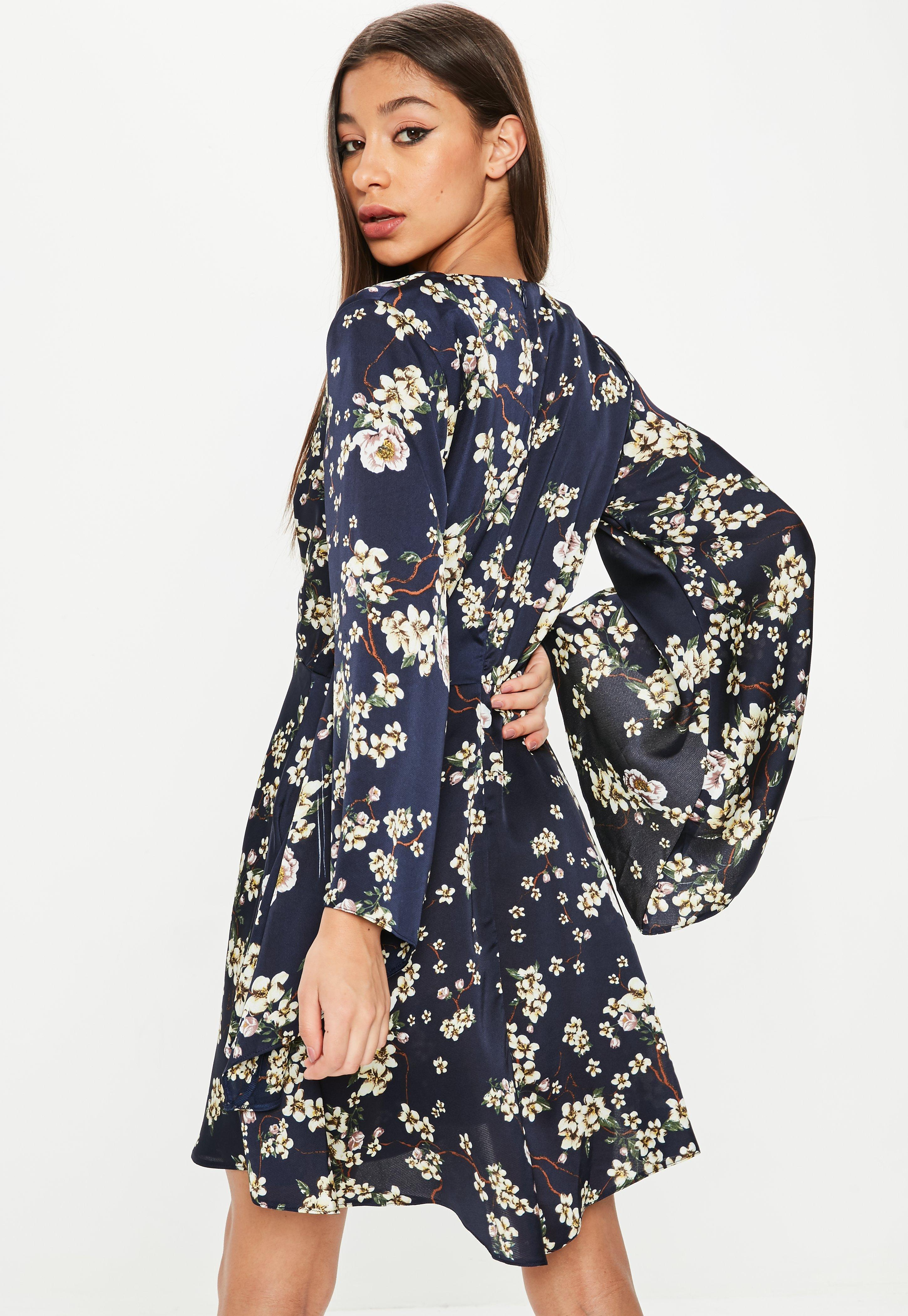 8f532f21ab Lyst - Missguided Navy Satin Floral Print Plunge Neck Skater Dress ...