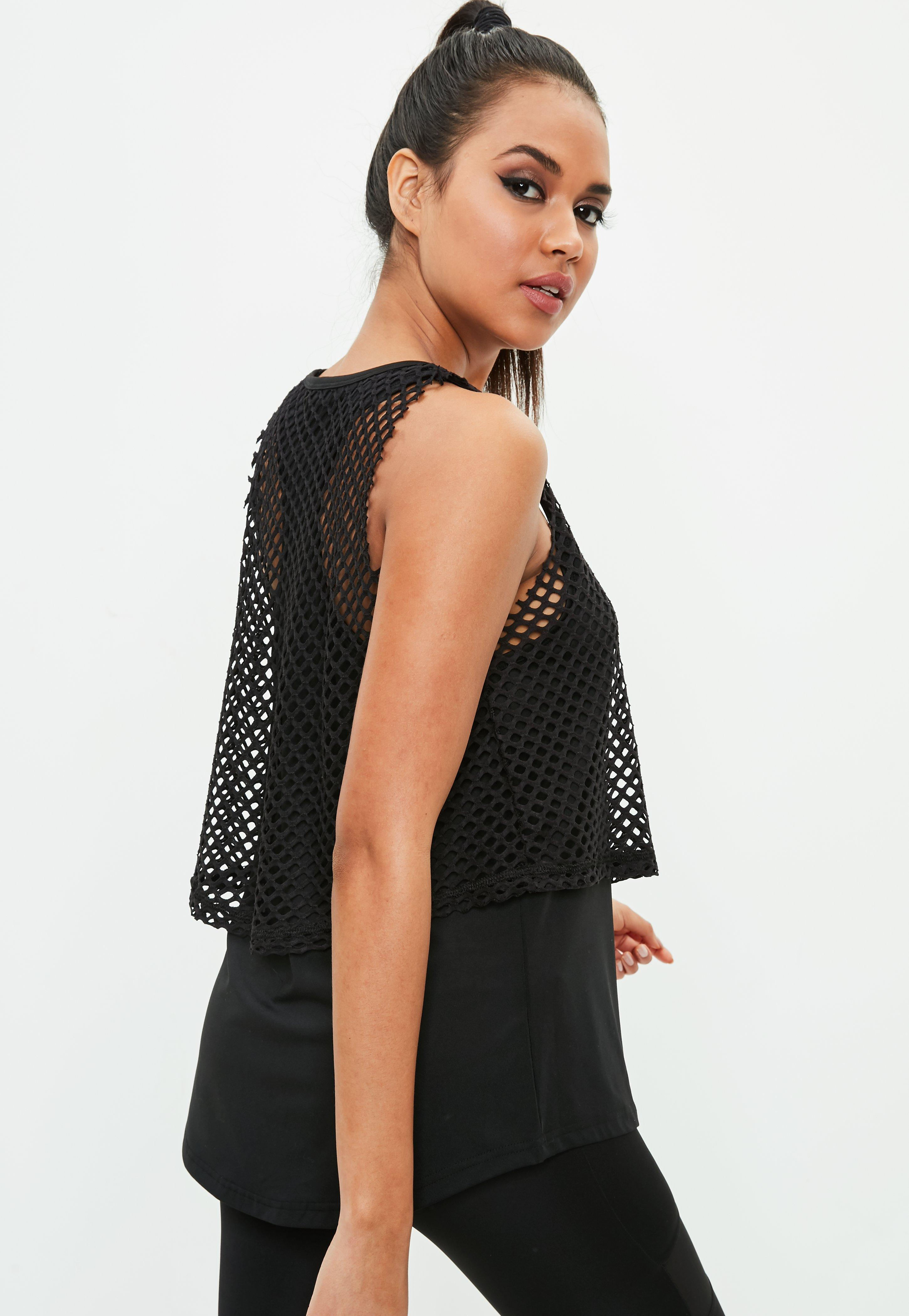 e1dd76fe241 Lyst - Missguided Active Black Fishnet Overlay Top in Black