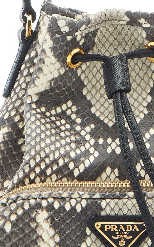 650d8ee4e2d1 Prada Python Print Leather Bucket Bag - Lyst