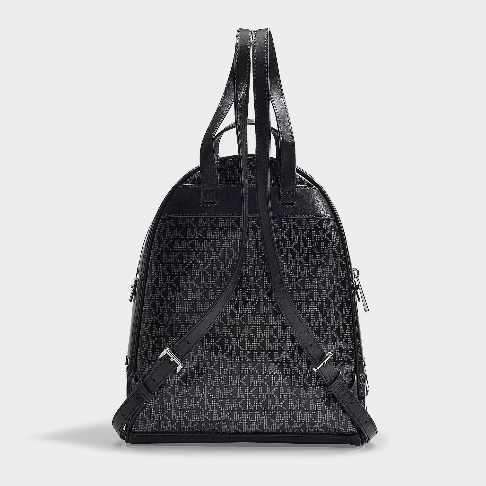 ef72abb132bc3d MICHAEL Michael Kors - Rhea Zip Medium Backpack In Black And Silver Pvc -  Lyst. View fullscreen